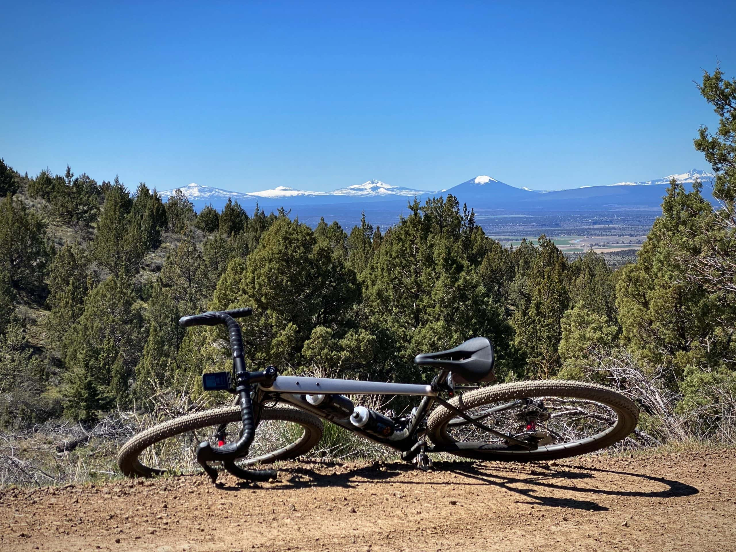 Bike on gravel road with Cascade mountains in the background.
