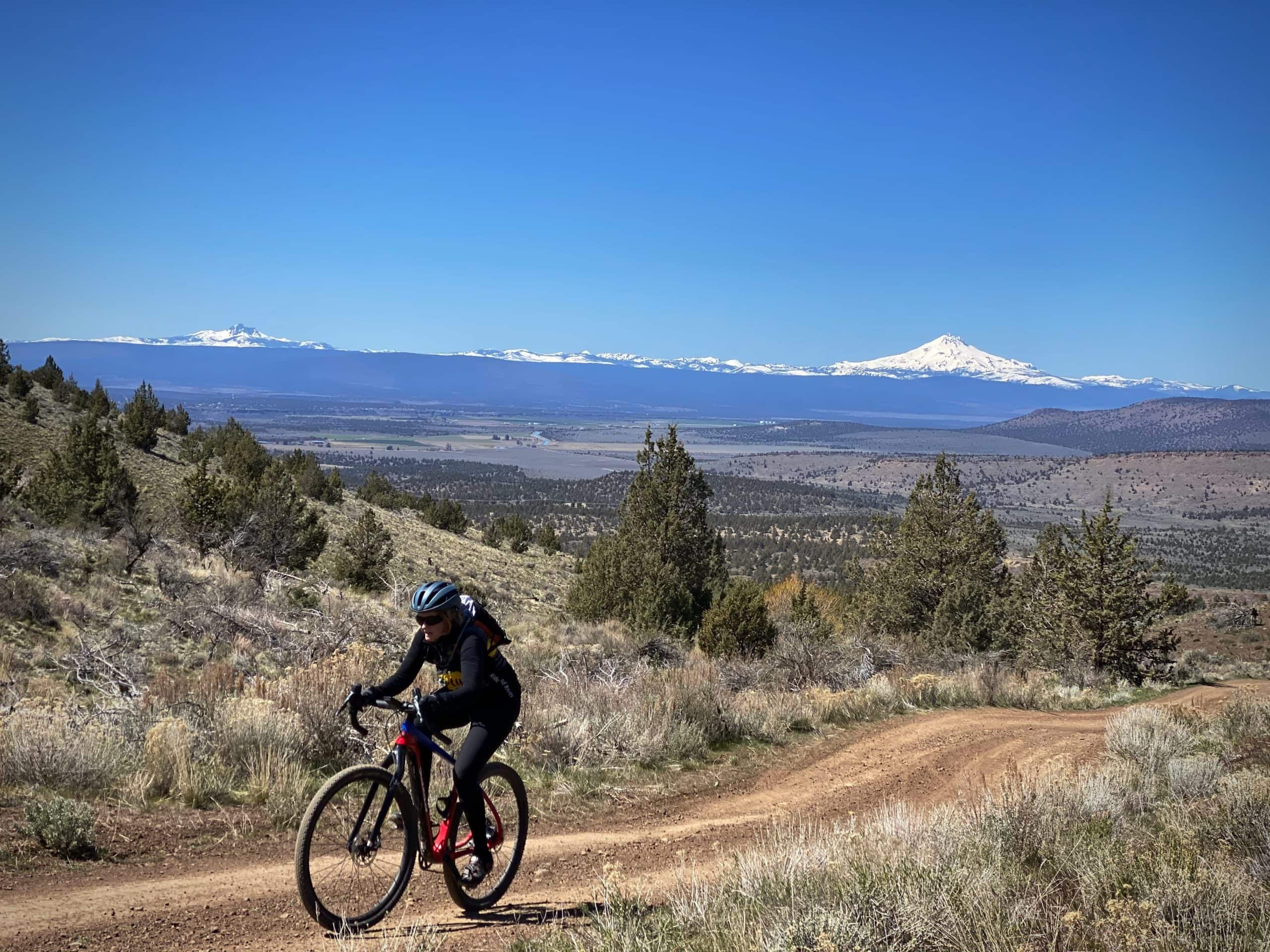 Gravel Girl nearing the high point for the day near Smith Rock state park in Oregon.
