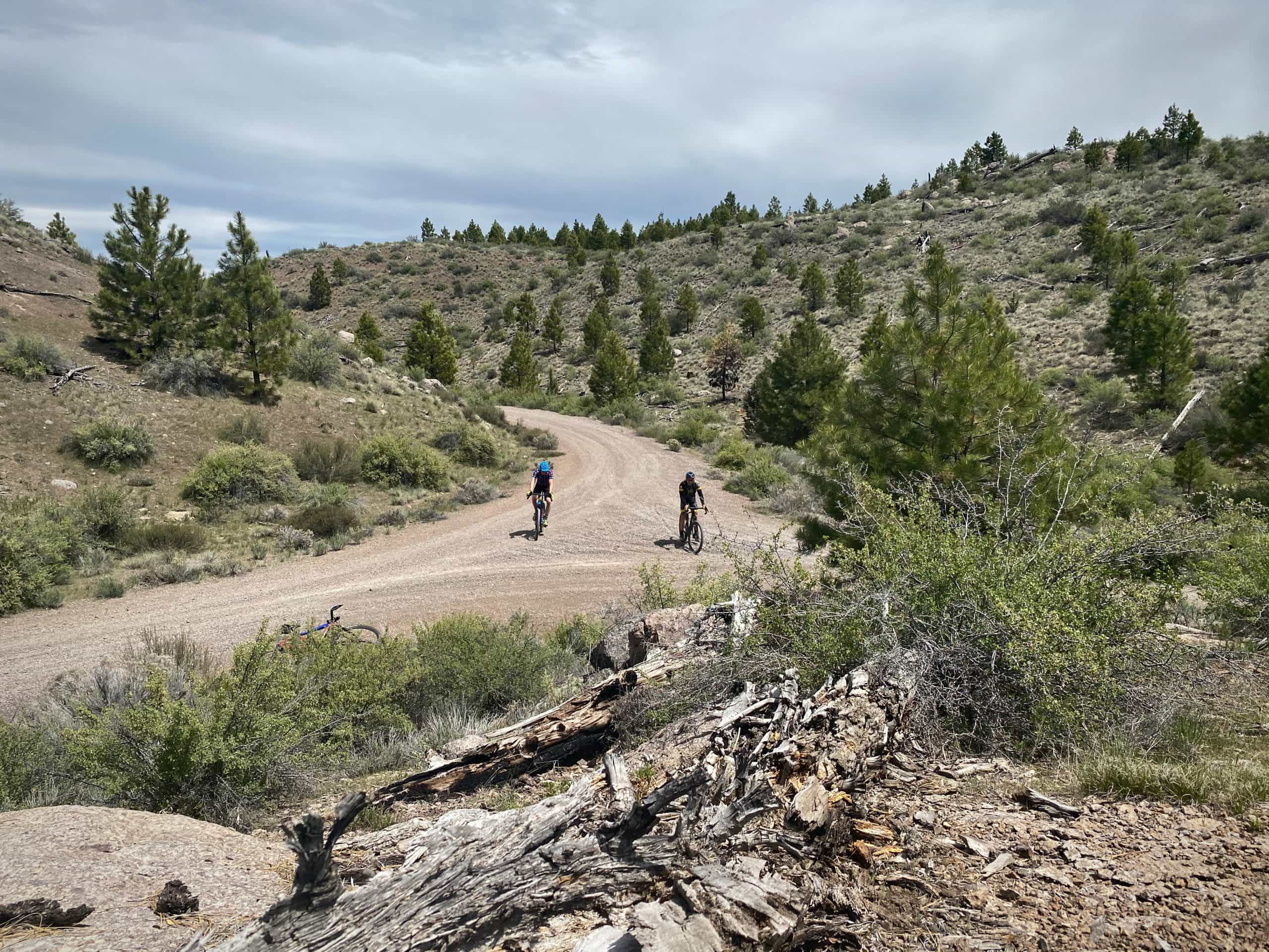 Two gravel cyclists coming to an intersection on the Egypt Canyon route on Dirty Freehub.