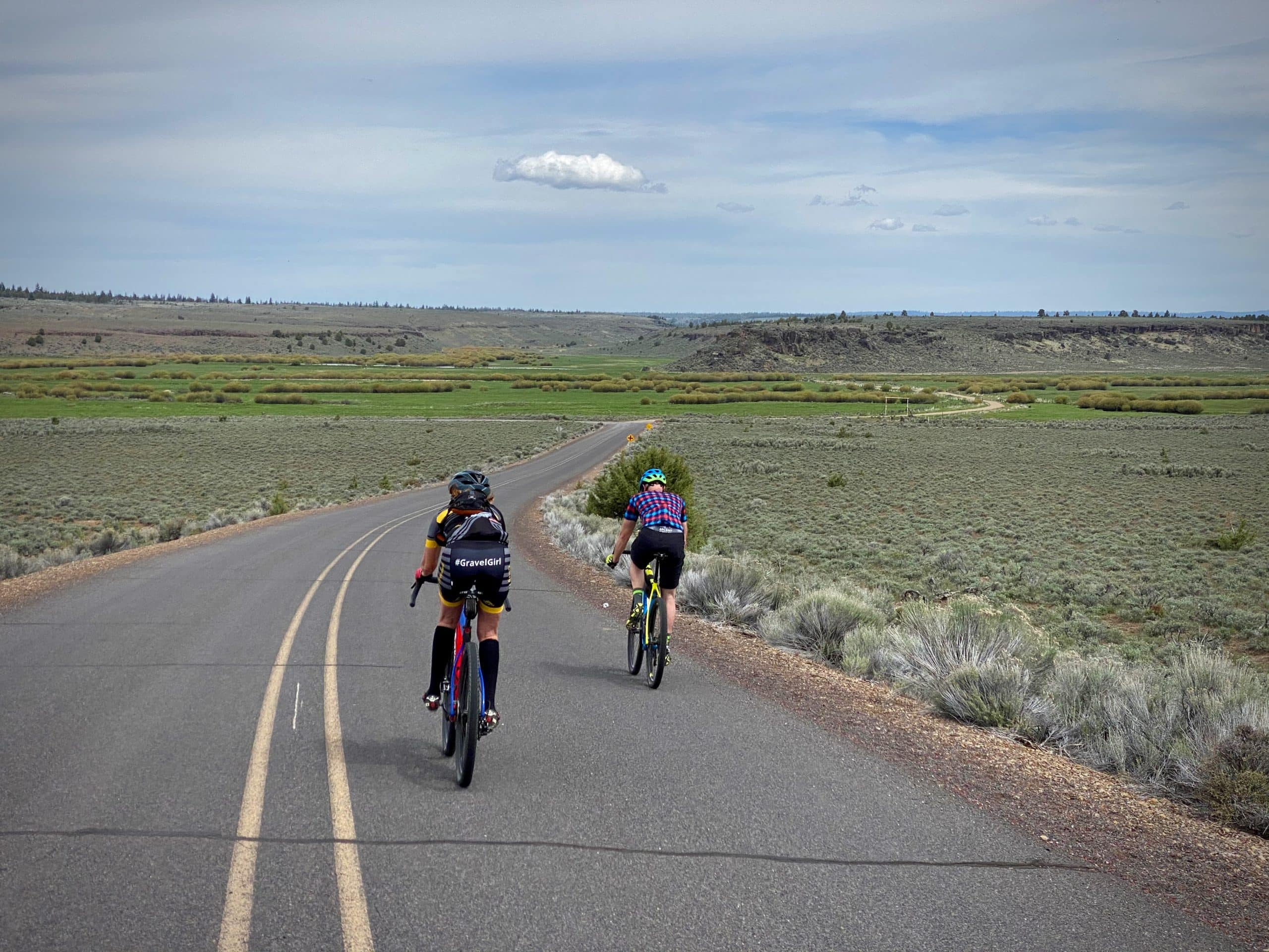 Two gravel cyclists dropping into Upper Silver Creek Valley in Oregon.