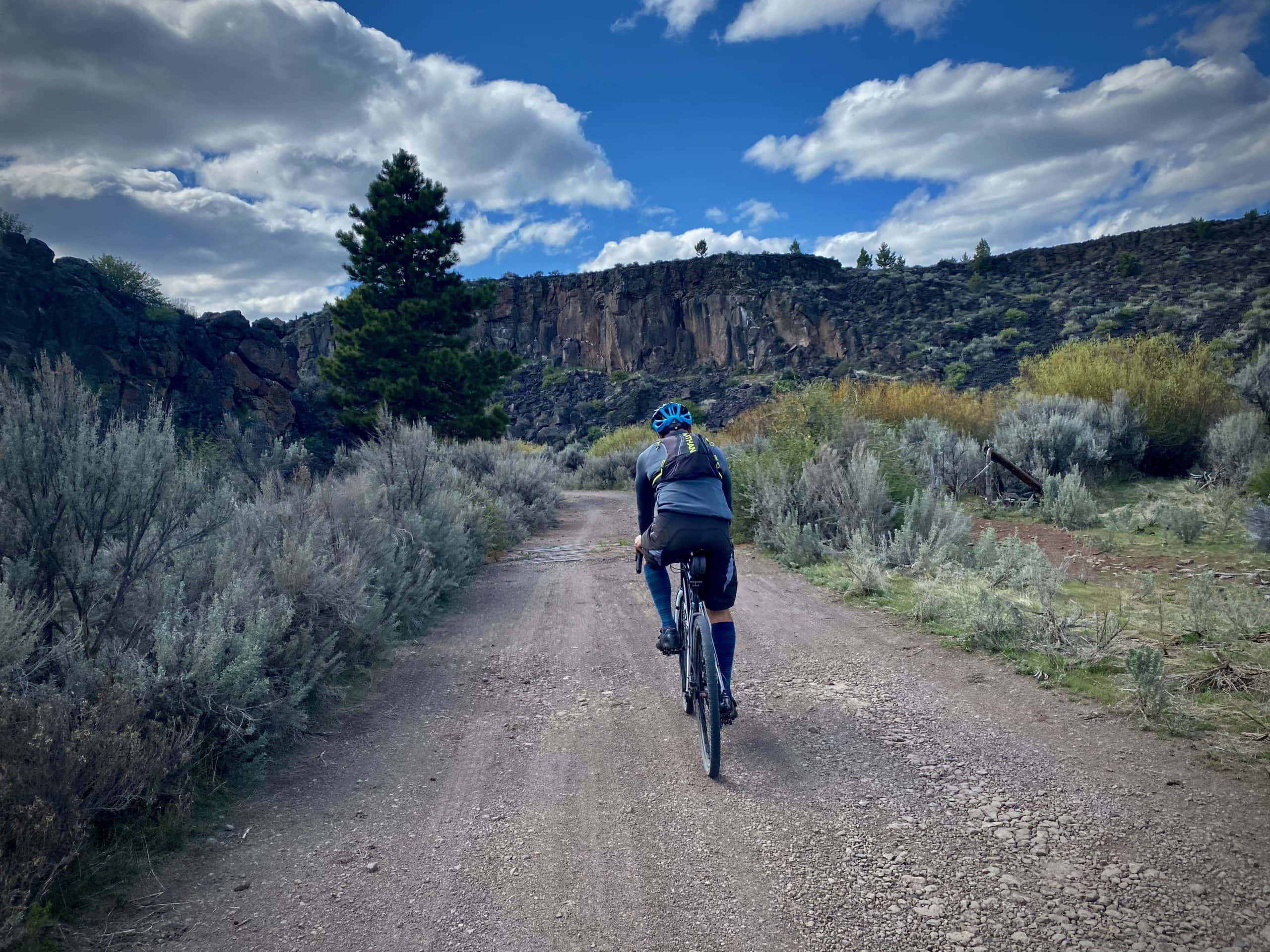 Cyclist approaching the entrance to Egypt canyon near Riley, Oregon.