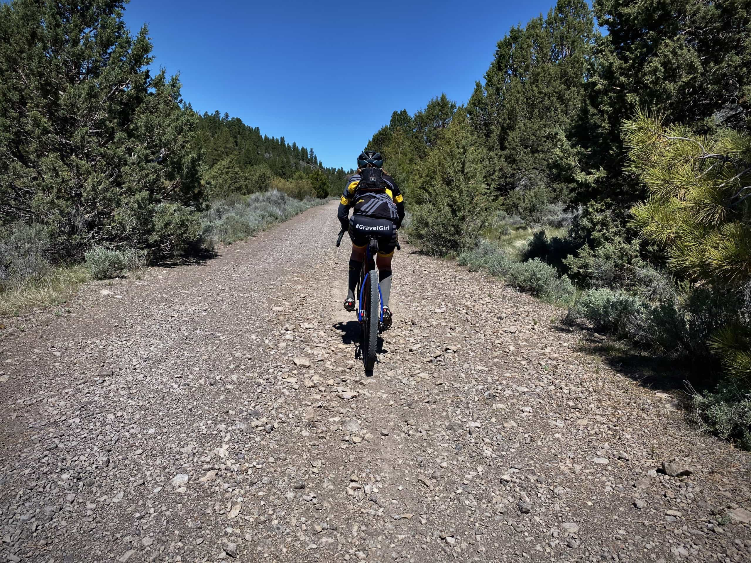 Gravel cyclist on difficulty and chunky forest service road in the Ochoco National Forest near Burns, Oregon.