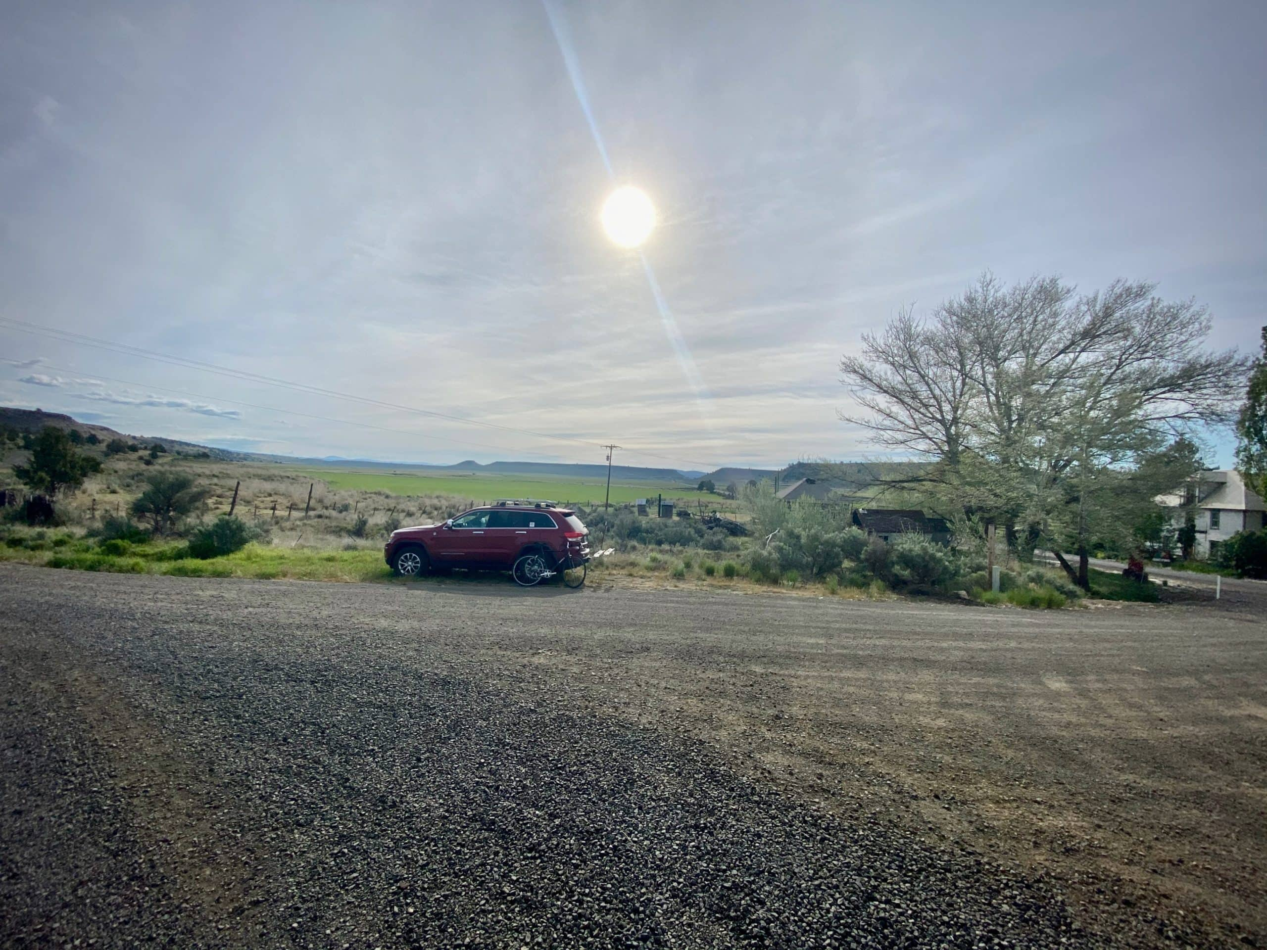 A makeshift gravel lot parking area in Paulina, OR.