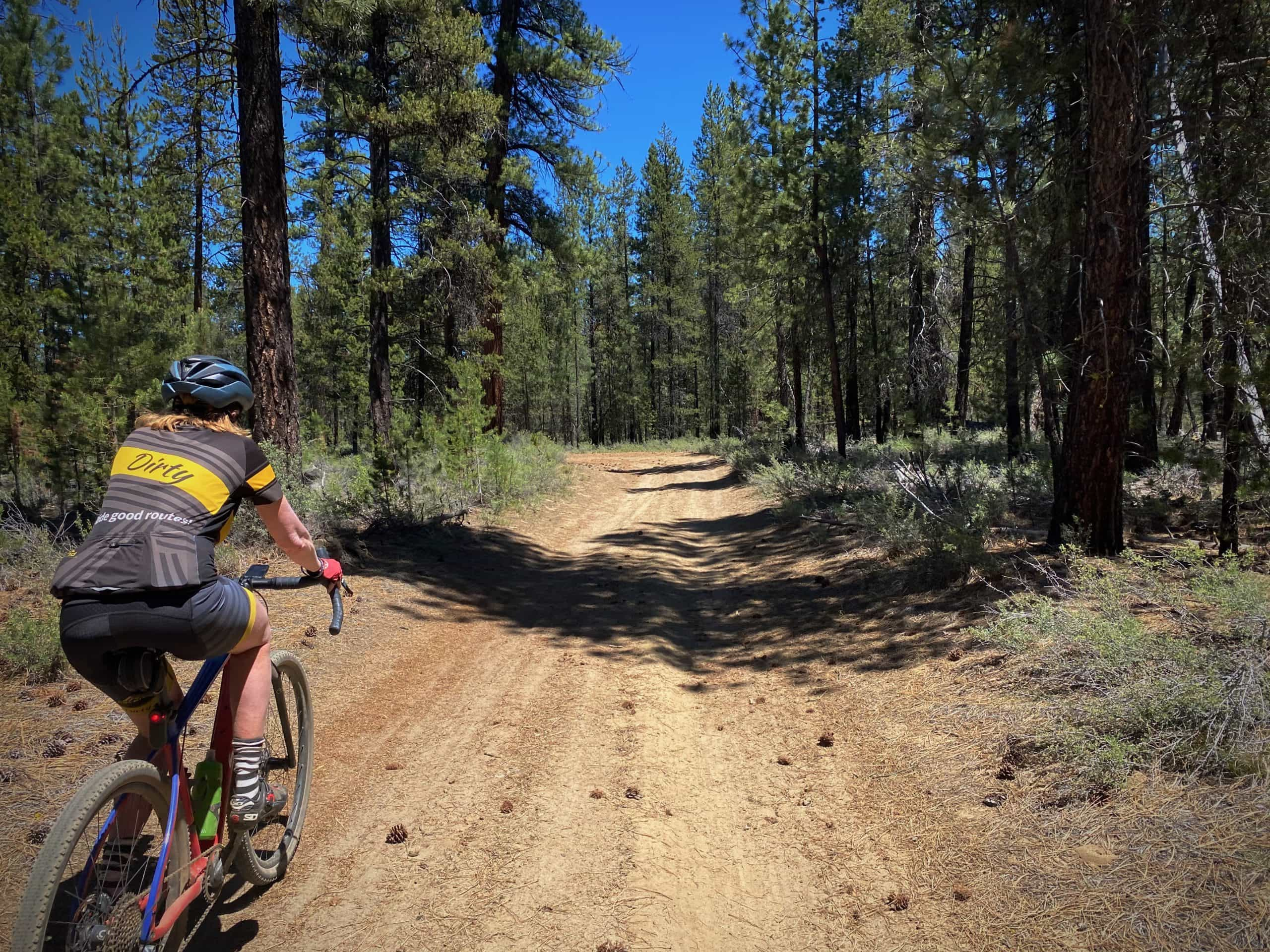 Gravel Girl riding a dirt road around Bates Butte near LaPine State park.