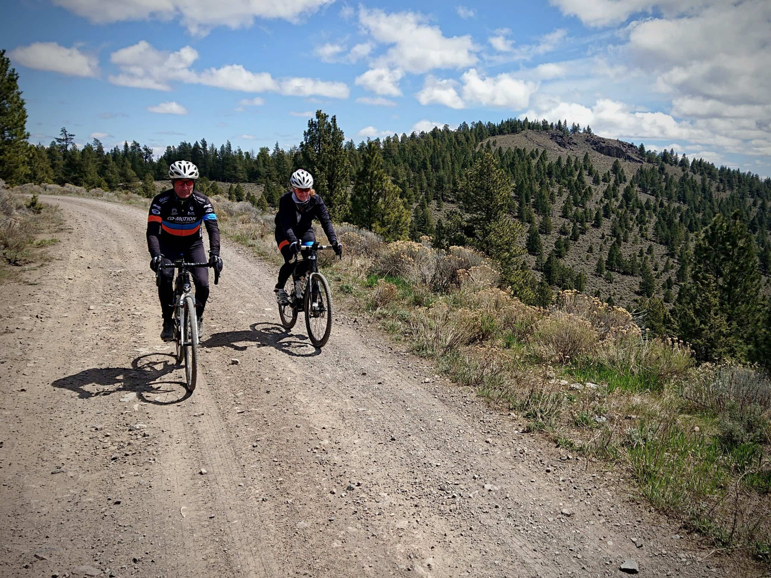 Gravel cyclists on forest service road at summit of Pine Mountain in Central Oregon.