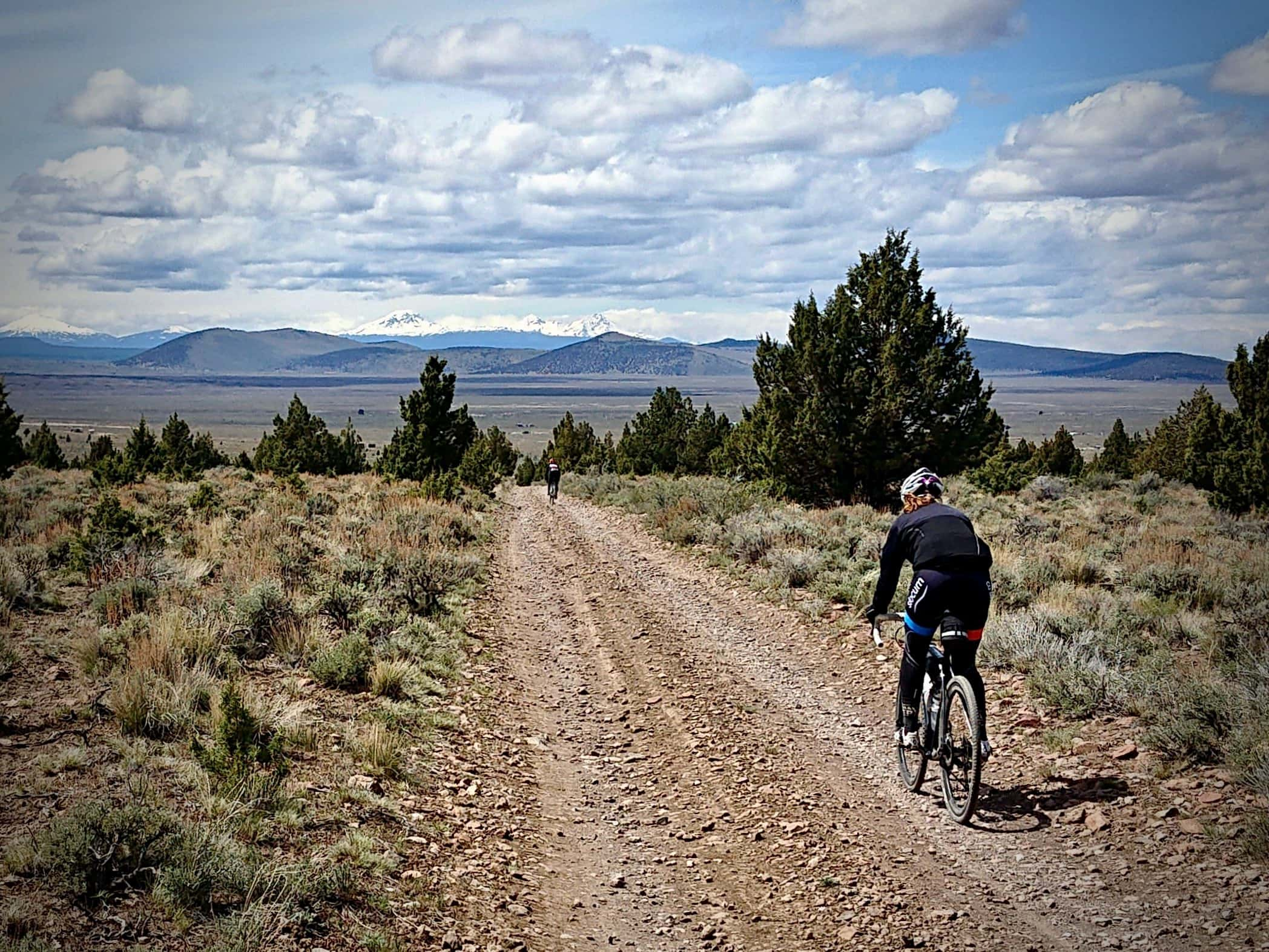 Cyclist on un-named gravel road connecting Pine Mountain road with Ford road in Oregon.