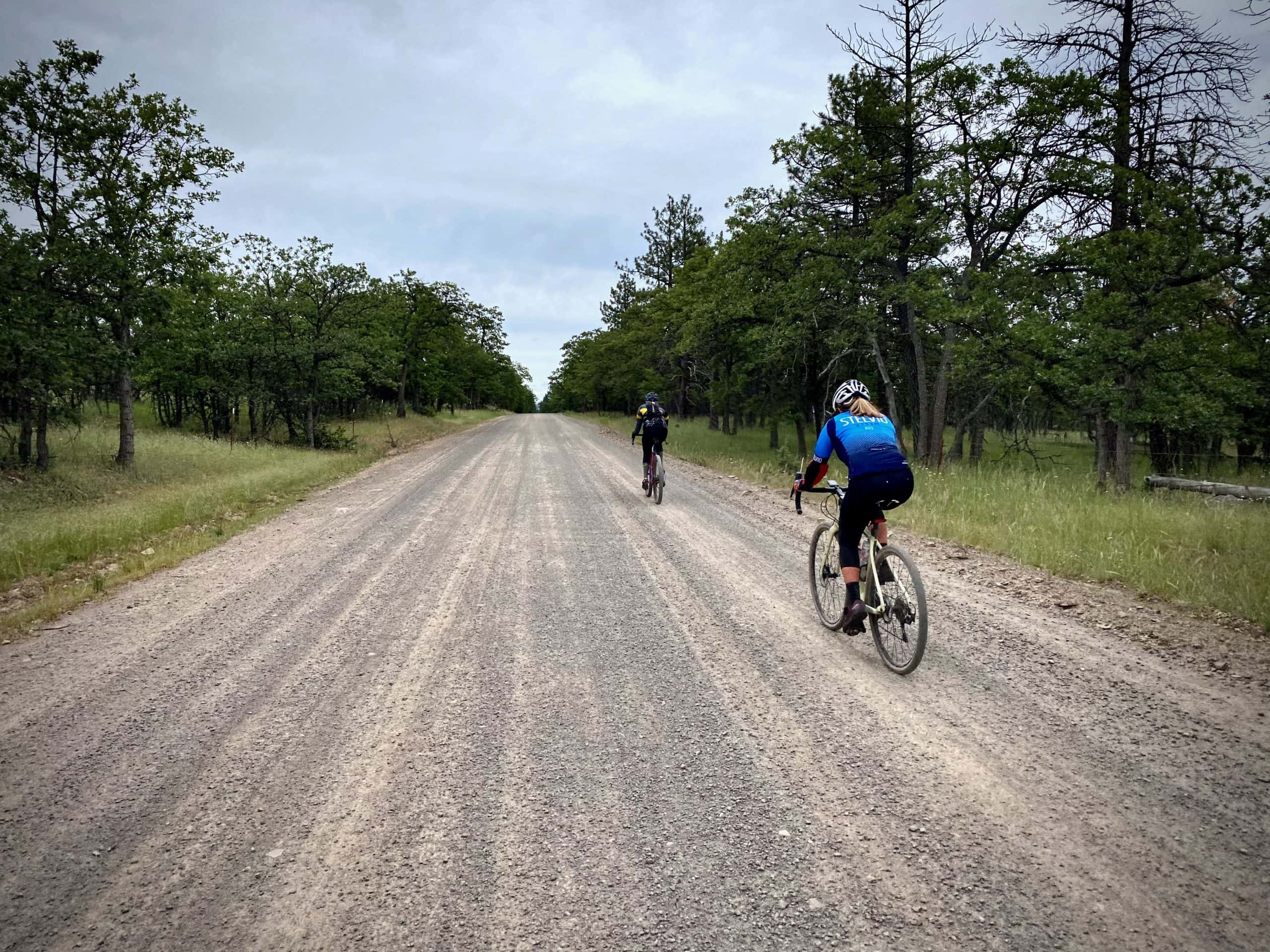 Two cyclists on gravel road near the ghost town of Friend, Oregon.