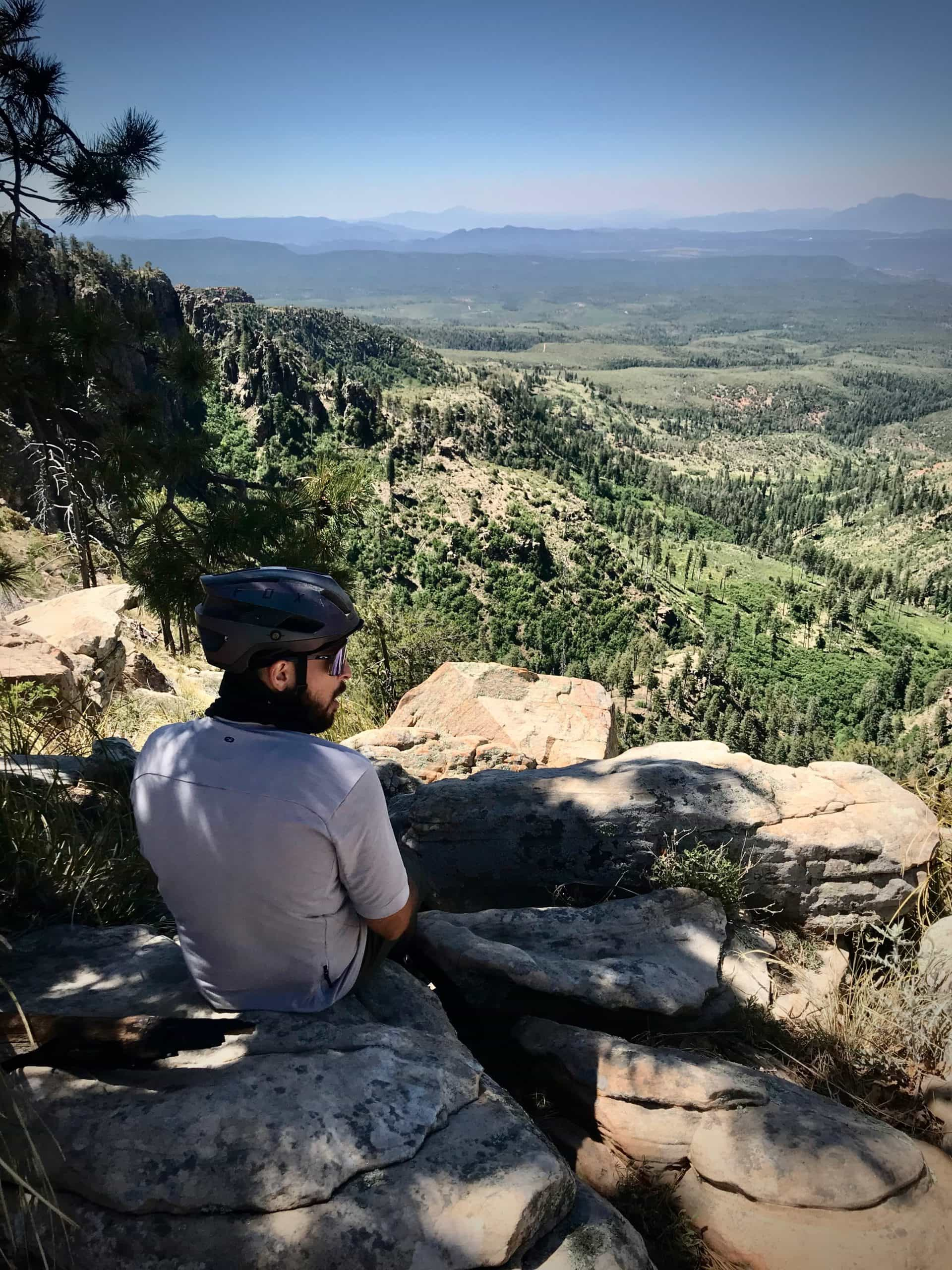 Bicycle rider looking east from the Mogollon Rim in central Arizona.