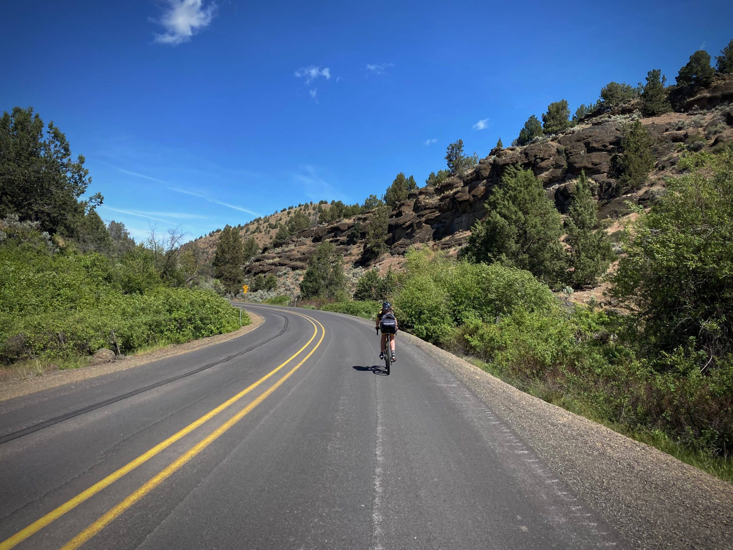Cyclist on the Painted Hills Scenic bikeway route near the Twickenham intersection in Central Oregon.