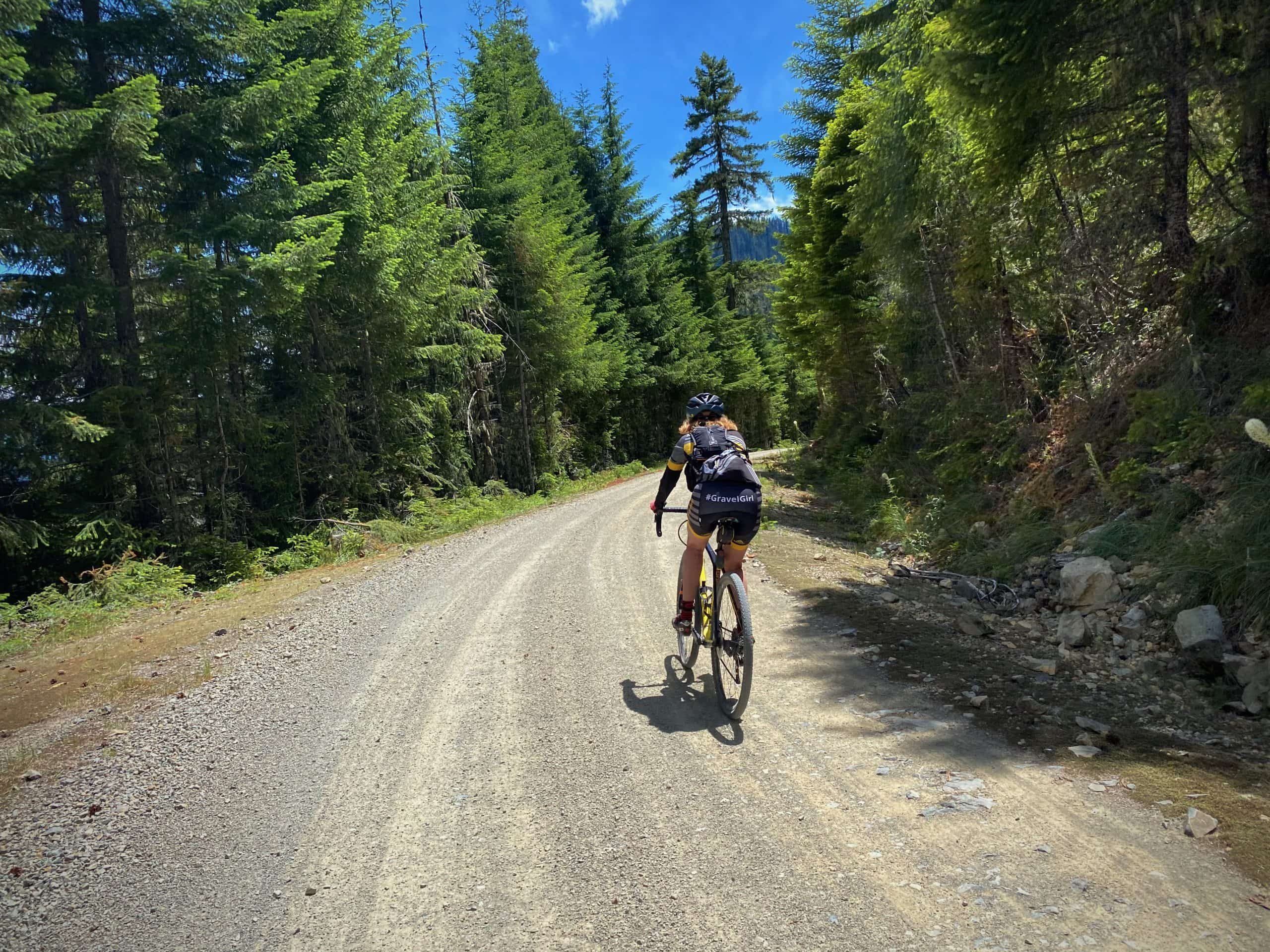 Gravel Girl on the big downhill of NF 1509 leading into Blue River, Oregon.