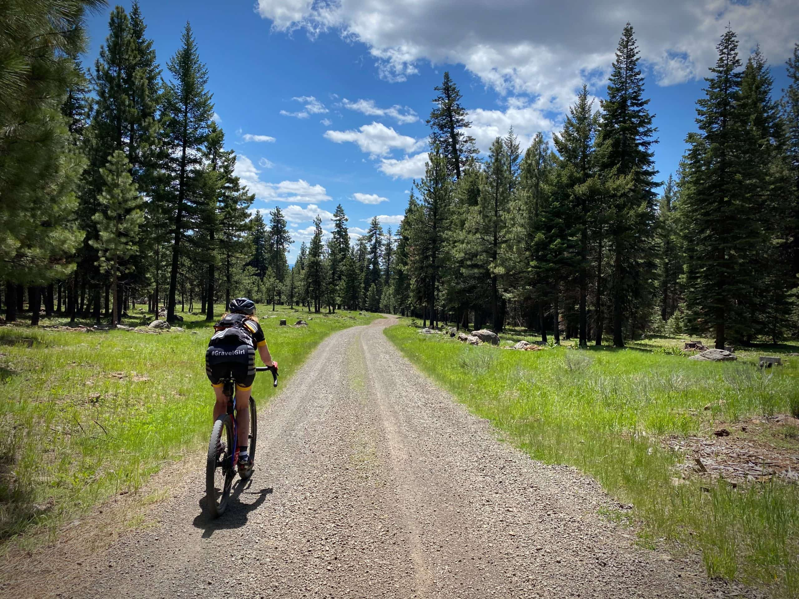Cyclist on gravel road near the Black Canyon Wilderness in Oregon.