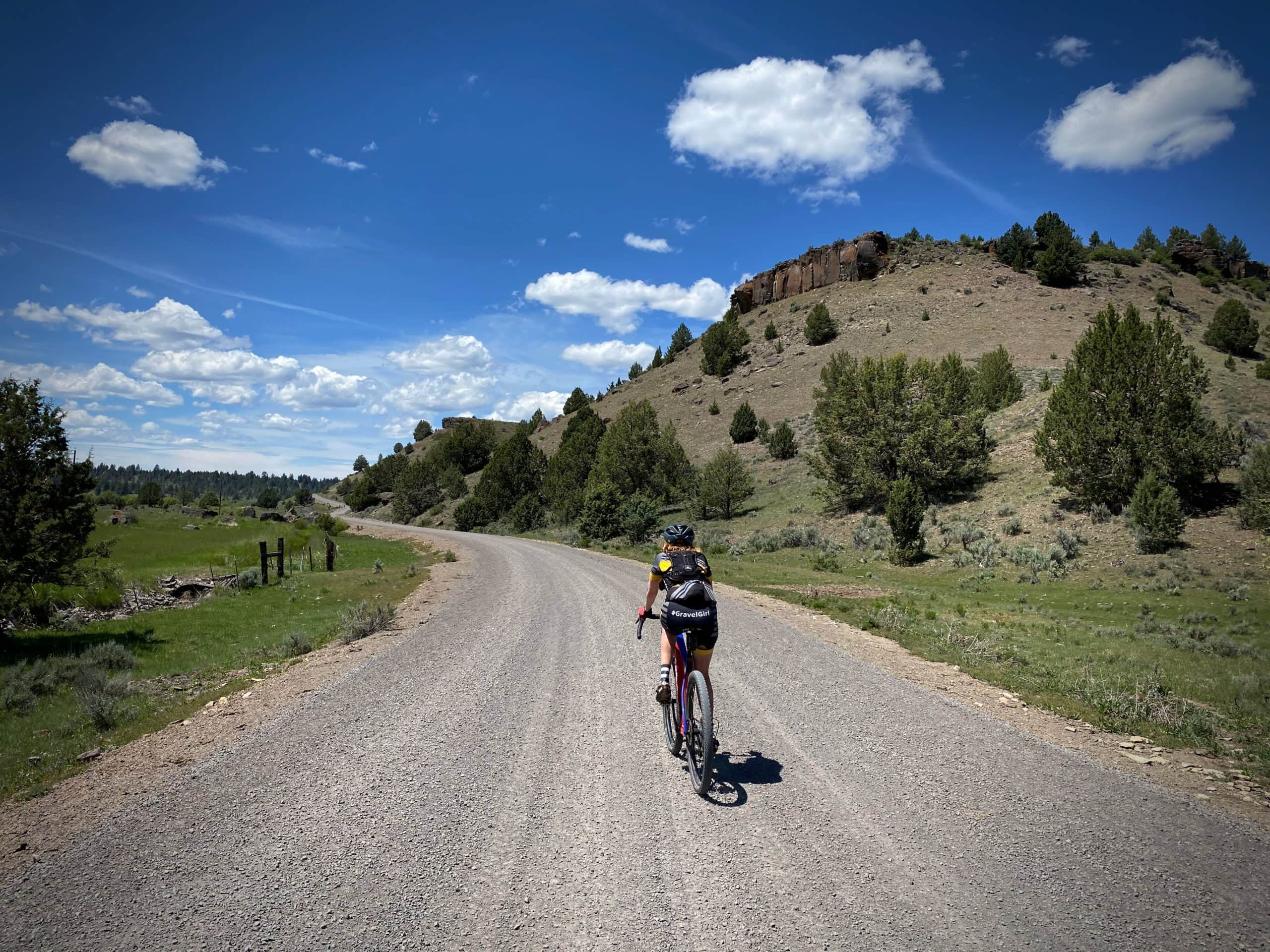 Gravel Girl riding gravel road in Powell Valley in Central Oregon,