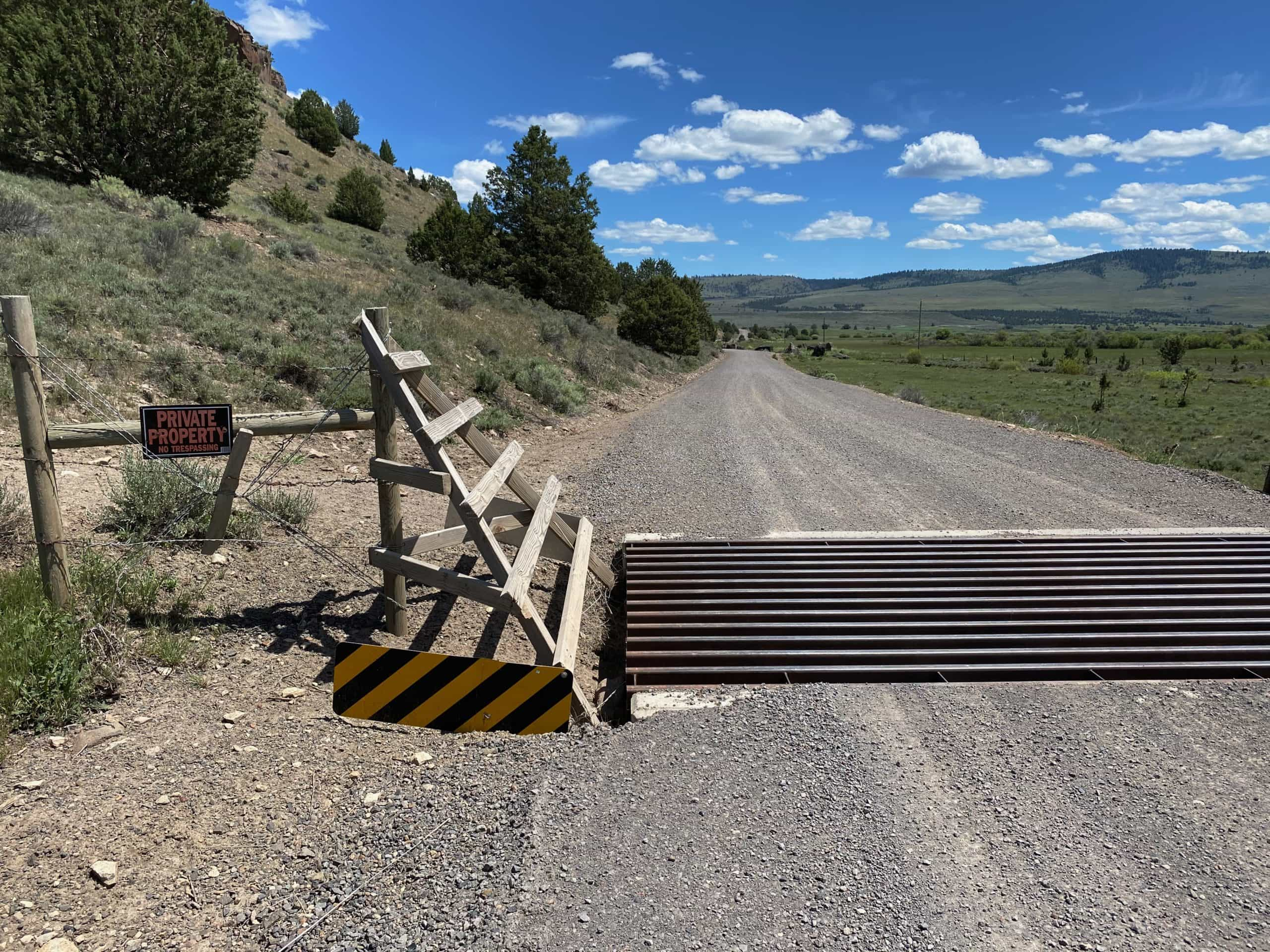 Cattle guard with No Tresspassing sign in Central, Oregon.
