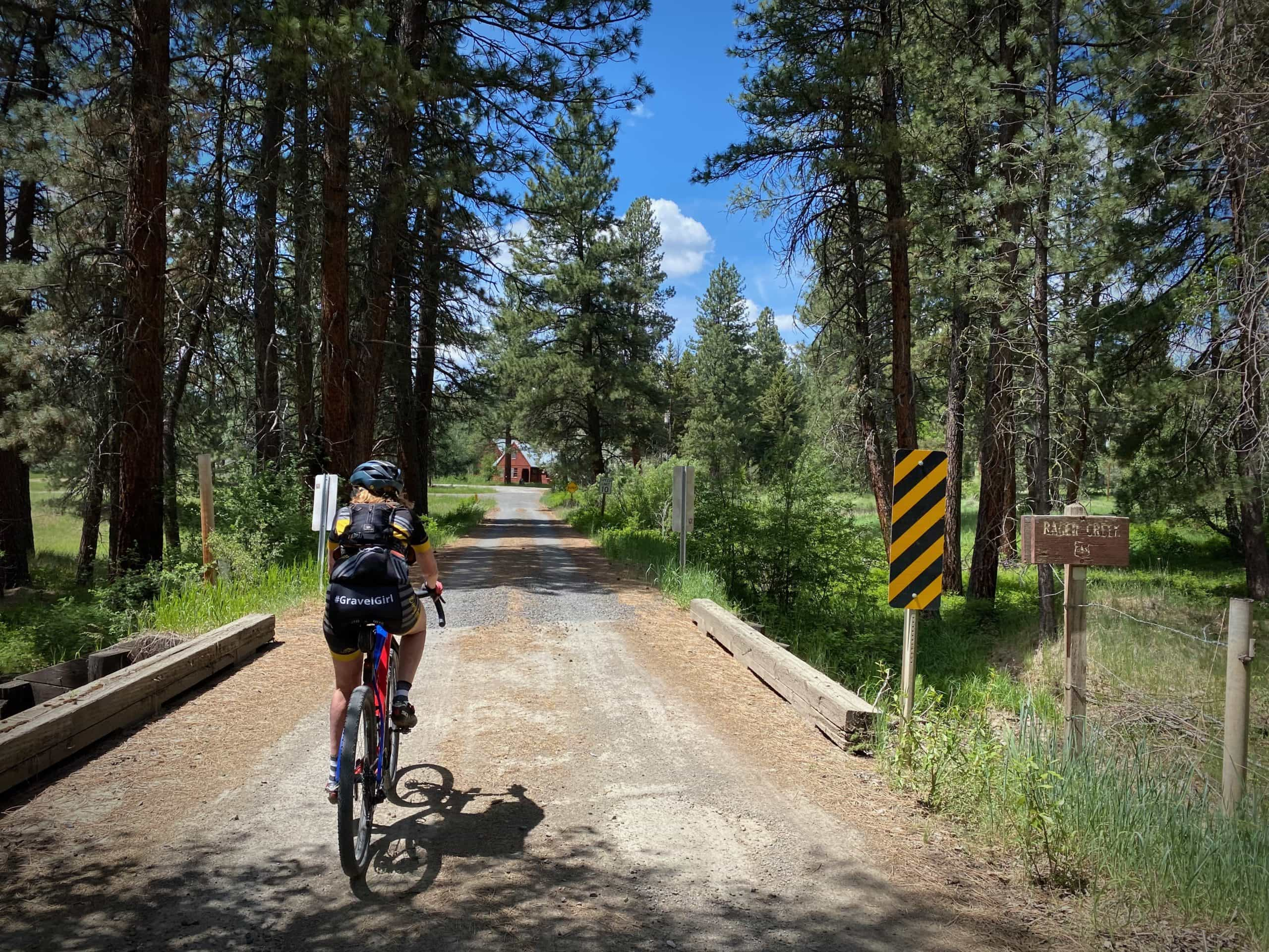 Cyclist approaching the Rager Ranger Station in the Ochoco National Forest.