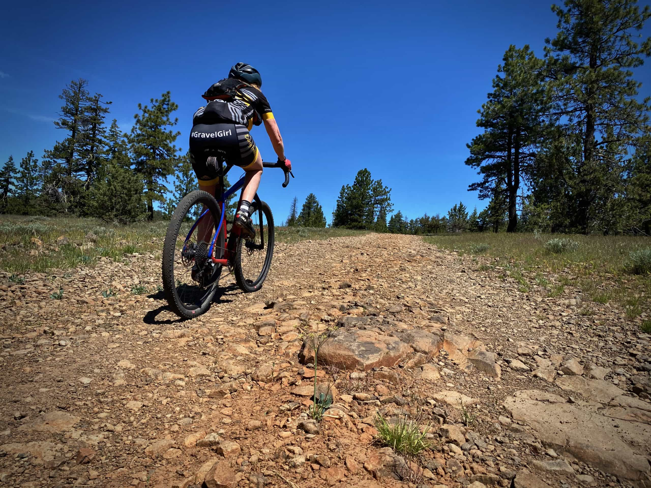 Gravel Girl working her way through a rough, gnarly gravel section in the Ochoco National forest near Prineville, Oregon.