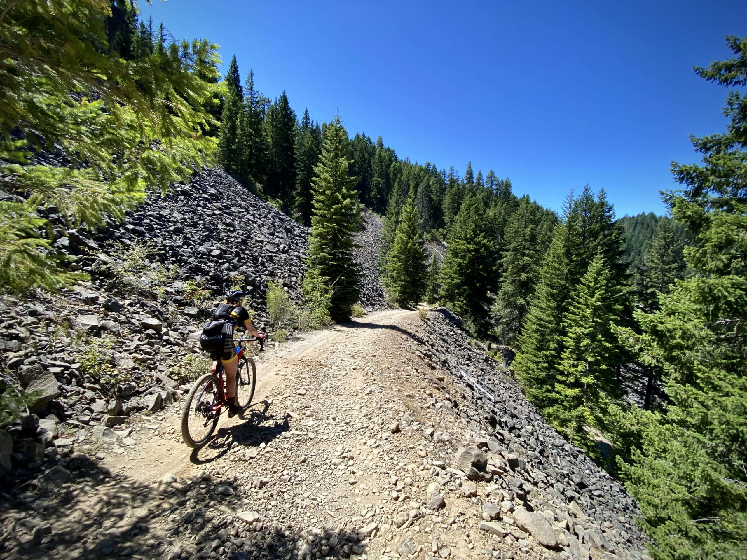 Cyclist descending the rugged jeep track to Keeps Mill along the White River in Oregon.