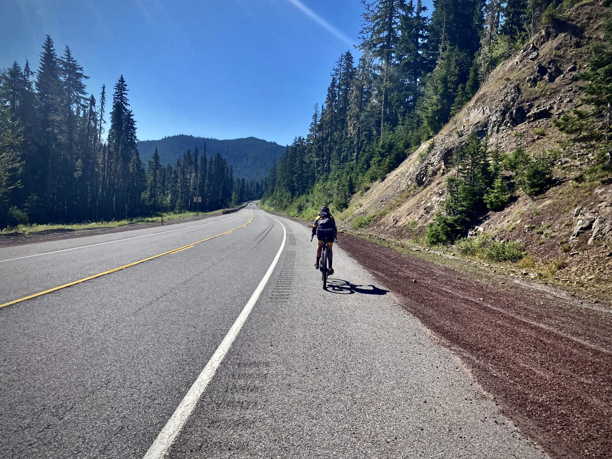 Cyclist on Highway 35, riding in the shoulder near Mt Hood.