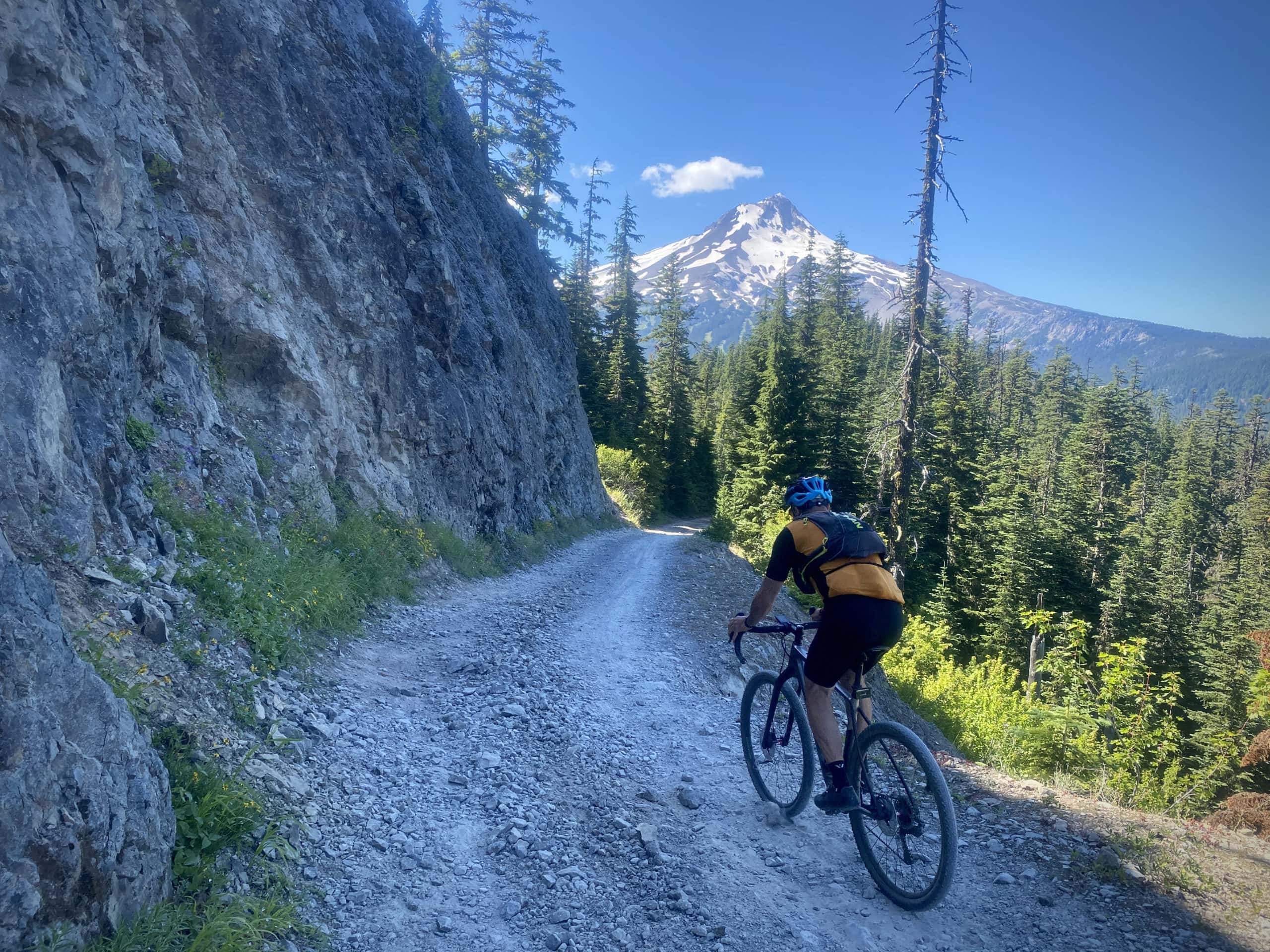 Gravel cyclist on the Terrible Traverse portion of Bennett road in the Mt Hood National Forest.