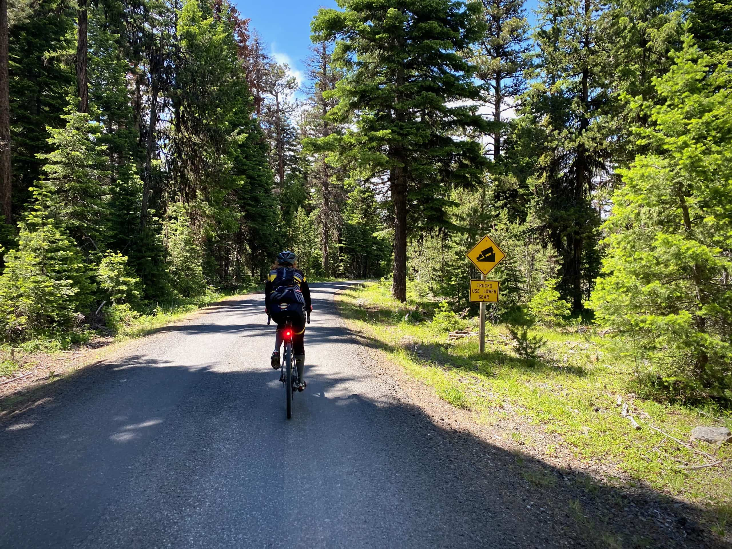 Cyclist getting ready to descent NF 12, Buck Point road, in the Ochoco Mountains.
