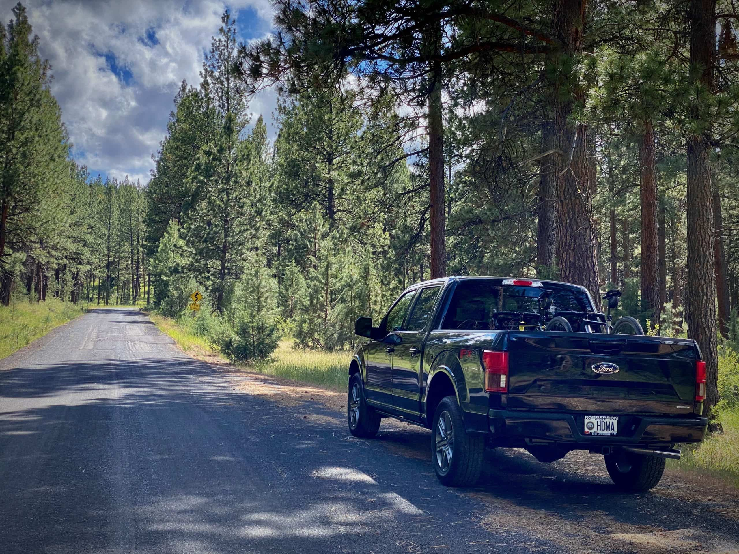 Ford F150 truck parked at pullout on NF 12 in the Ochoco Mountains near Mitchell, Oregon.