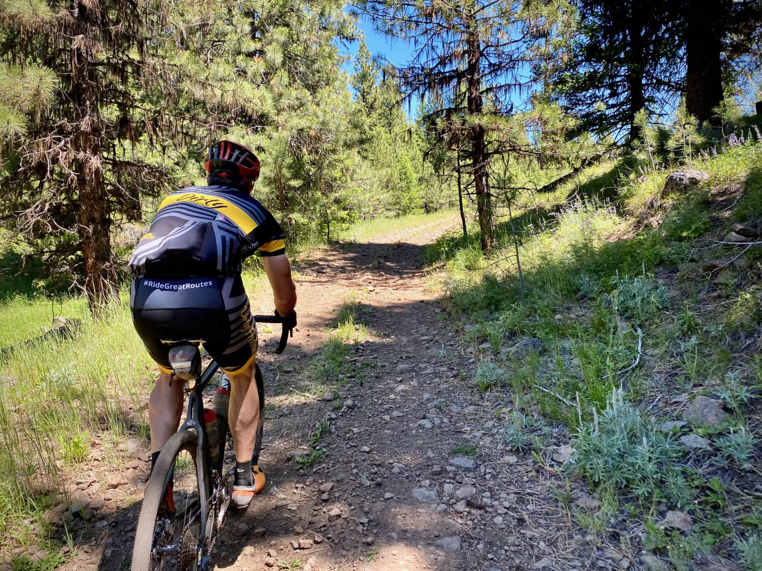 Gravel cyclist riding a rocky double track section in the Ochoco Mountains.