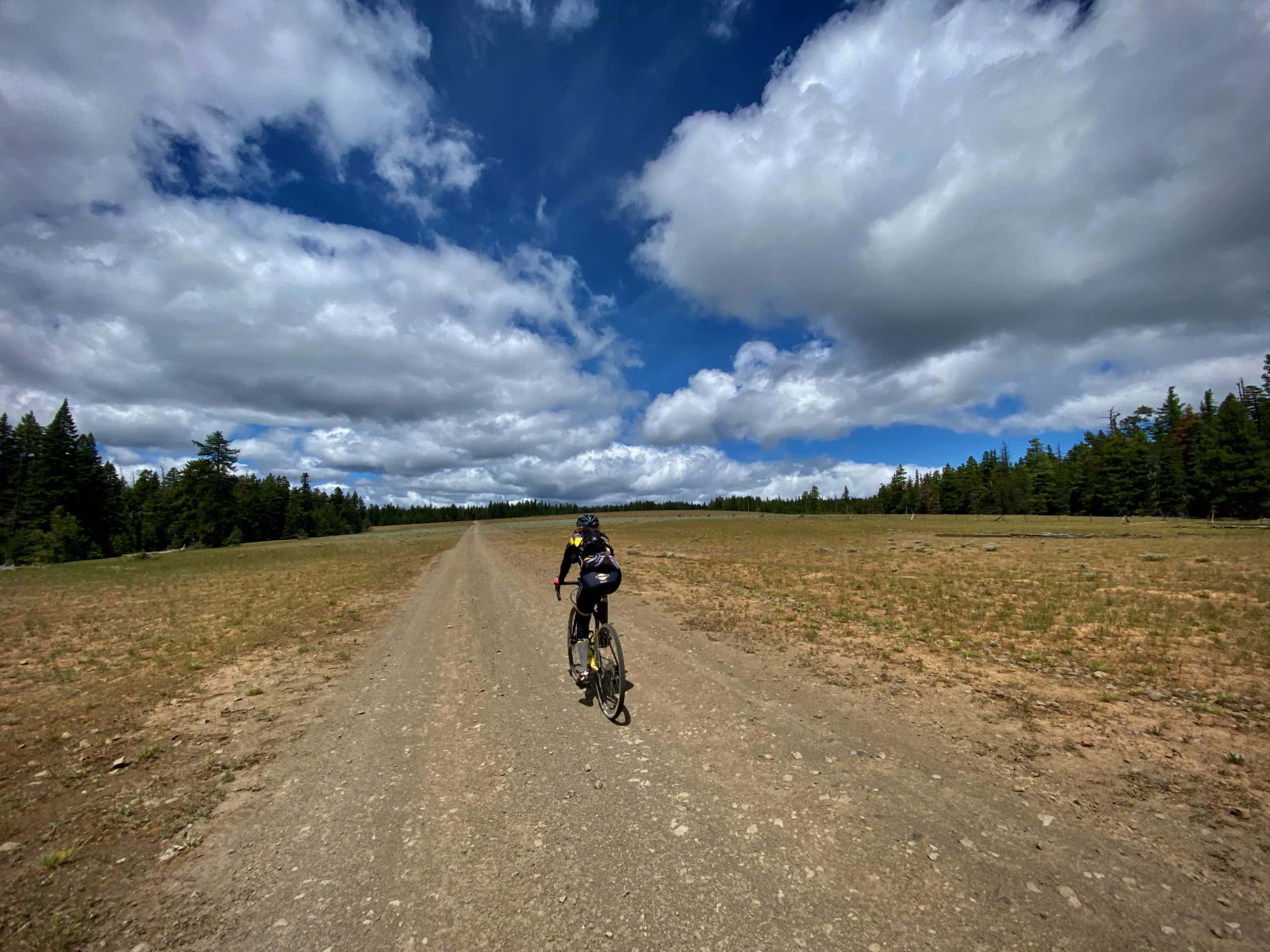 Gravel Cyclist riding through the Broadway lava field in the Ochoco National Forest.