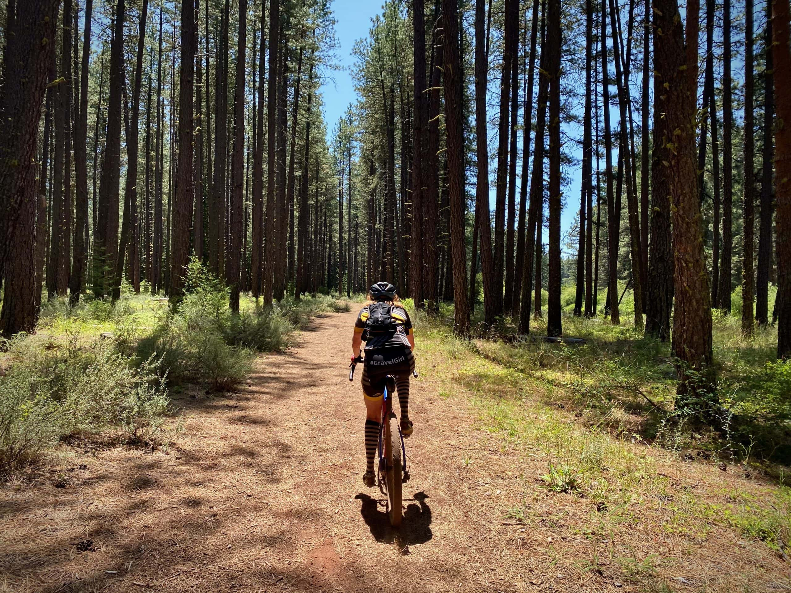 Gravel Girl on single-track / double-track trail, along the Metolius River,  just south of Camp Sherman, Oregon.