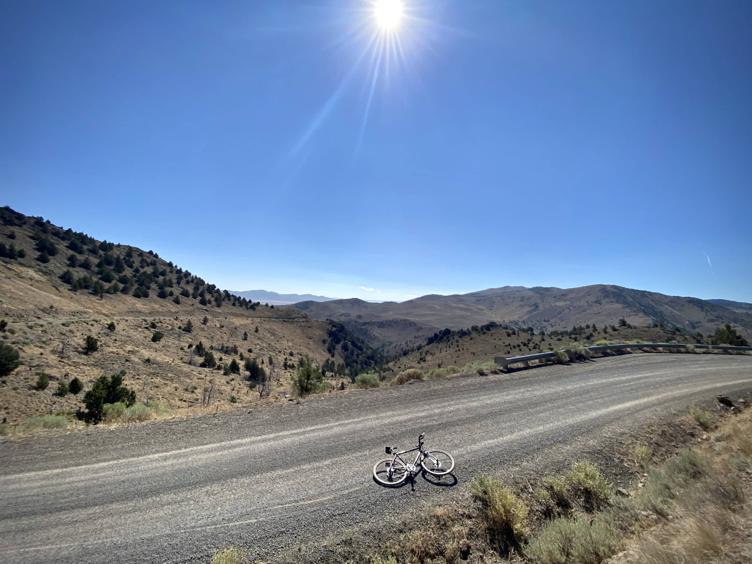 Gravel road with sweeping views of the hillsides, peaks, and mountains in Lake county, Oregon.