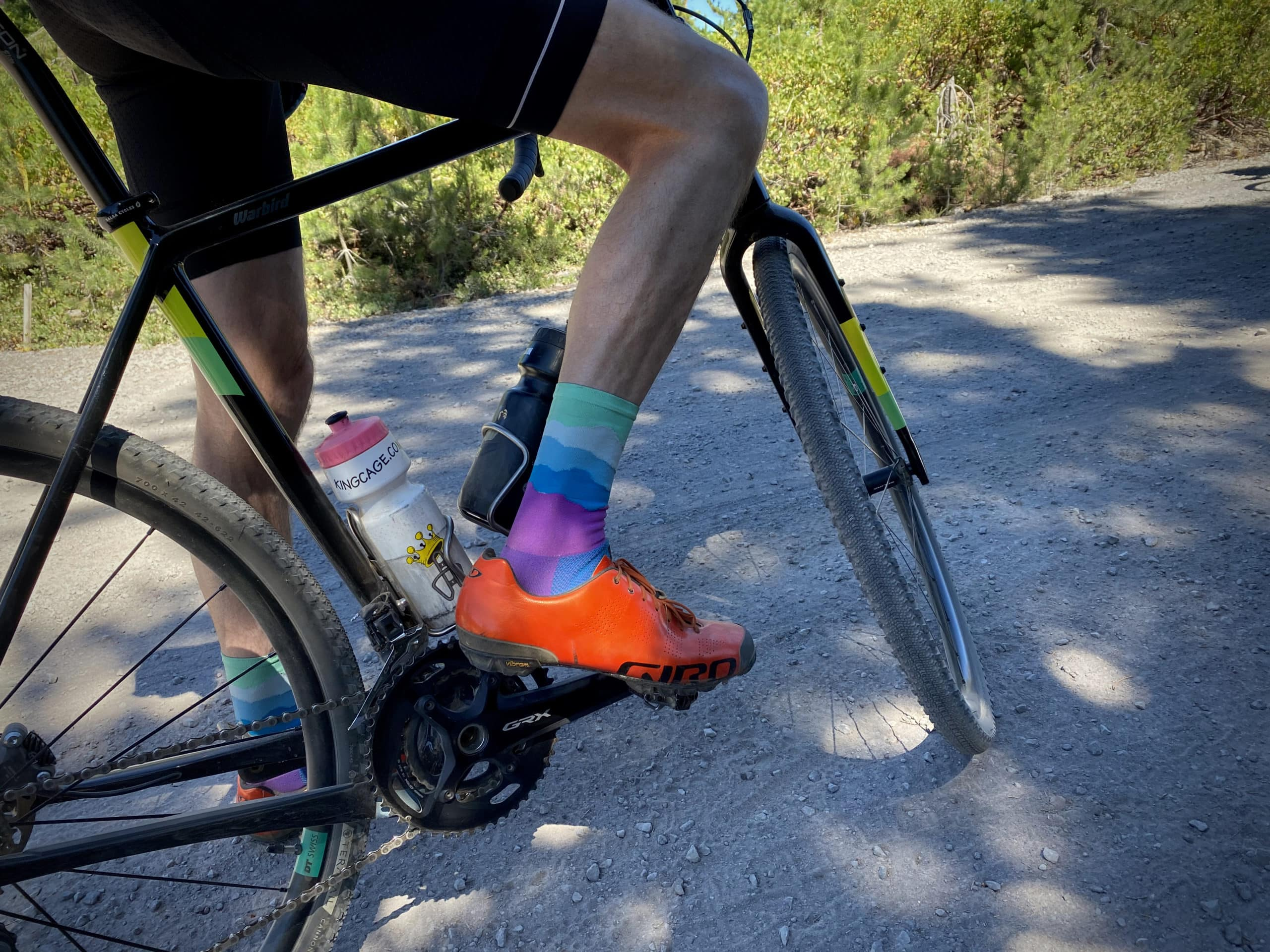 Cyclist with colorful shoes and socks.