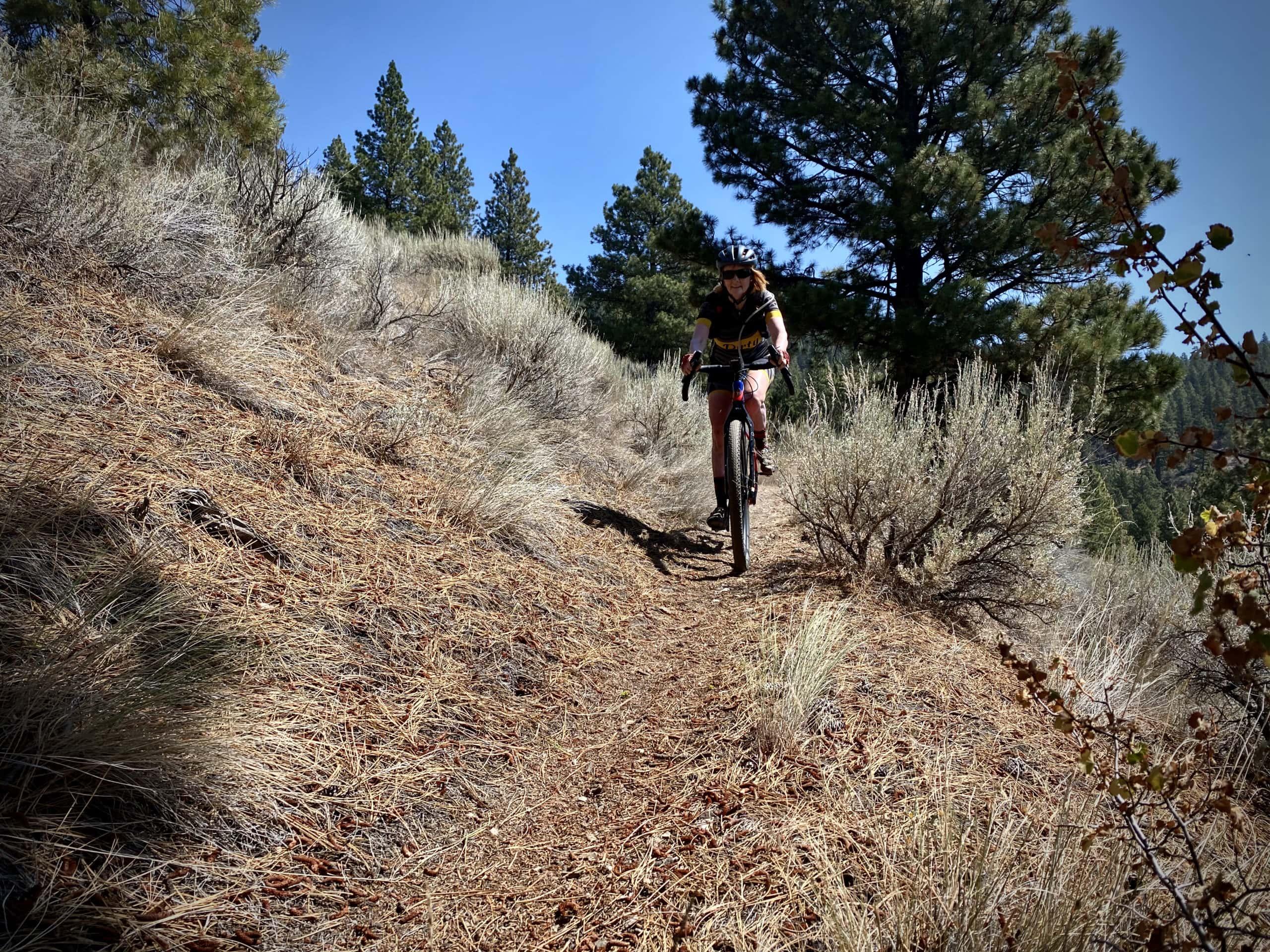 Gravel cyclist on single track trail in the Fremont National Forest.