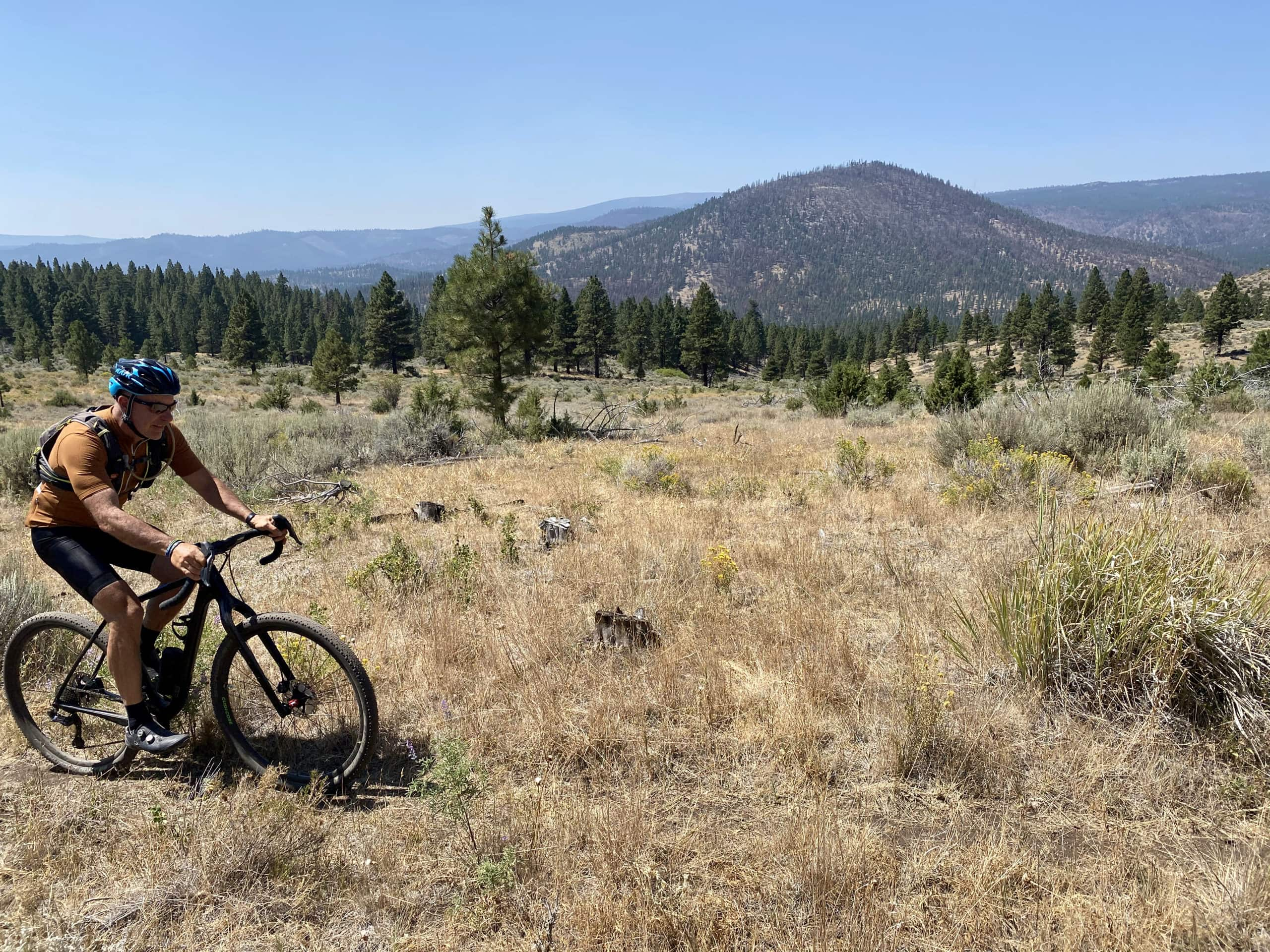 Cyclist riding the open hillsides on the Oregon Timber Trail after Cat Canyon,