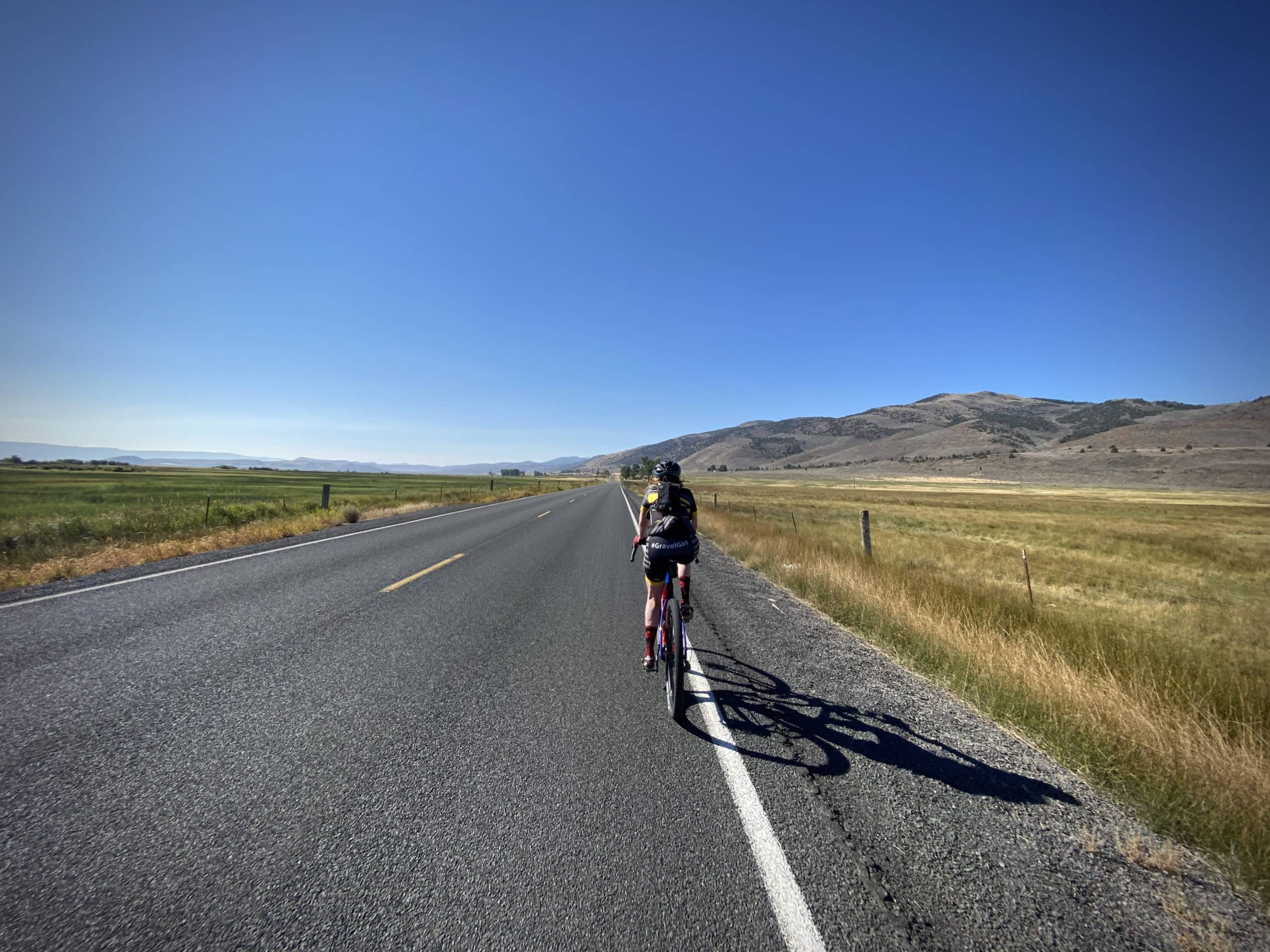 Cyclist on Highway 31 leading out of Paisley, Oregon.