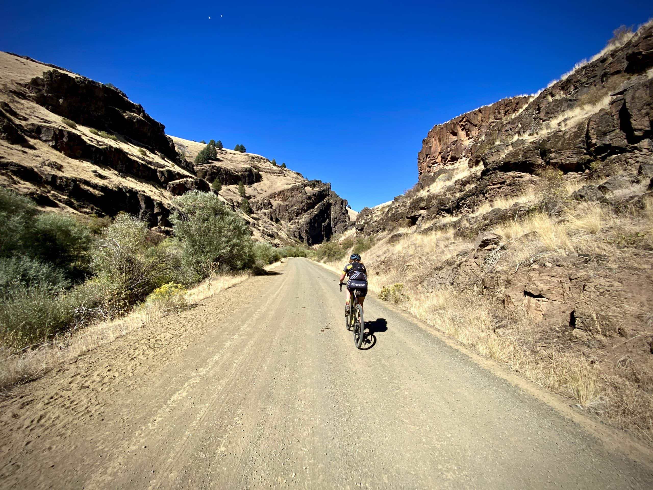 Gravel cyclist entering into the Black Canyon sector along the South Fork of the John Day River.