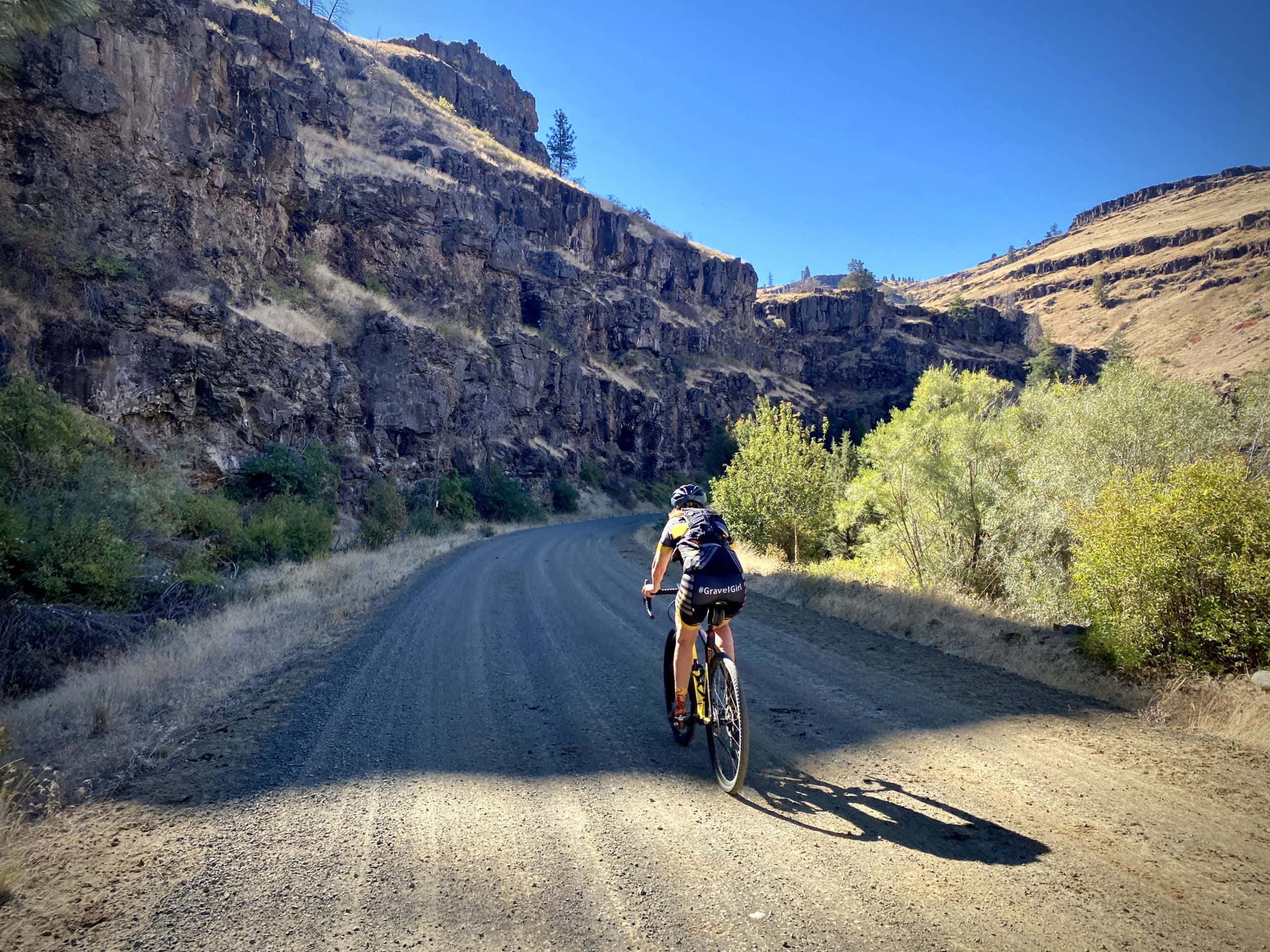 Gravel Girl riding into the Black Canyon section of the Murderers Creek gravel bike ride.
