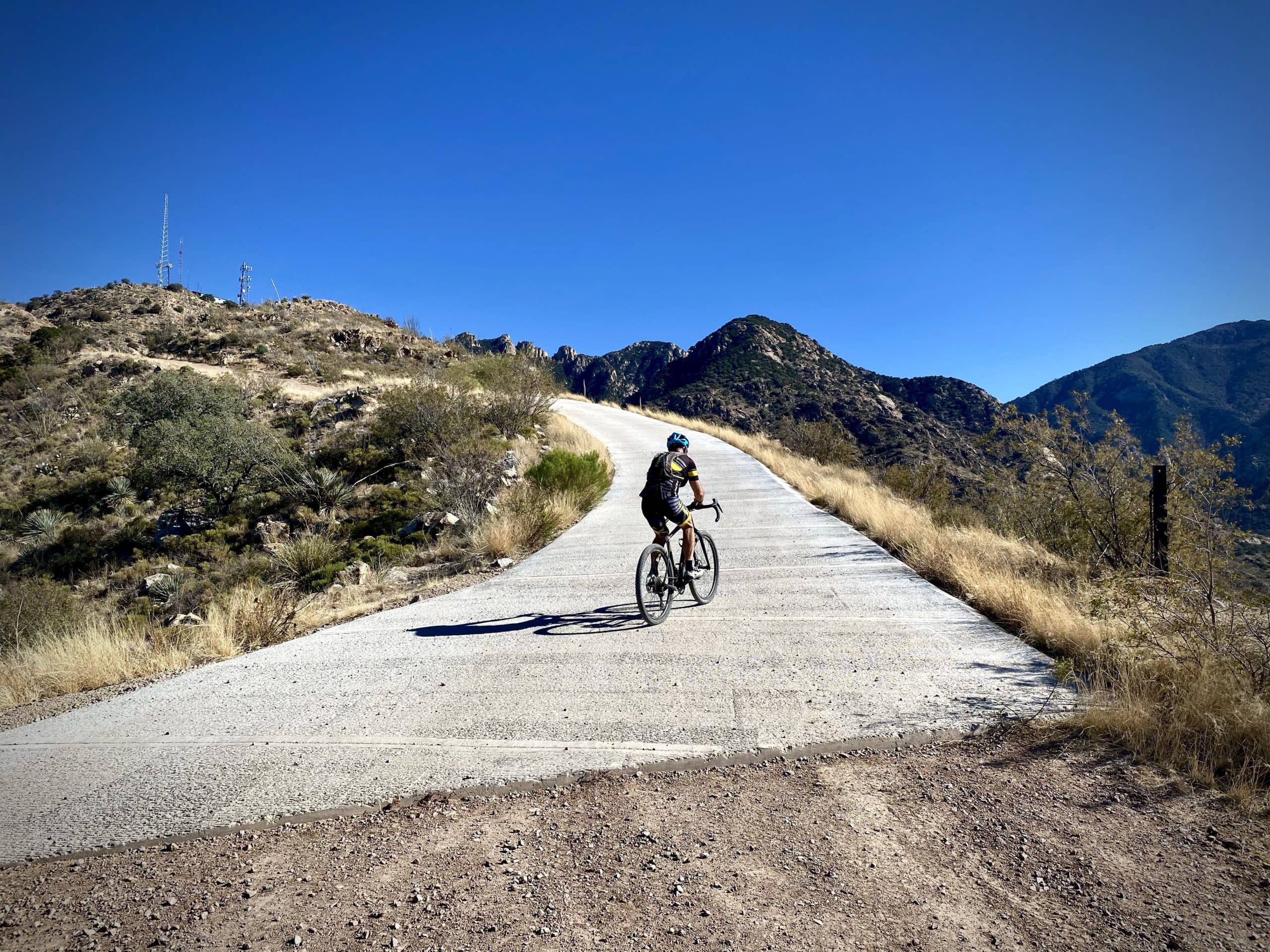 Cyclist climbing the first concrete pad leading to the radio towers in Green Valley, Arizona.