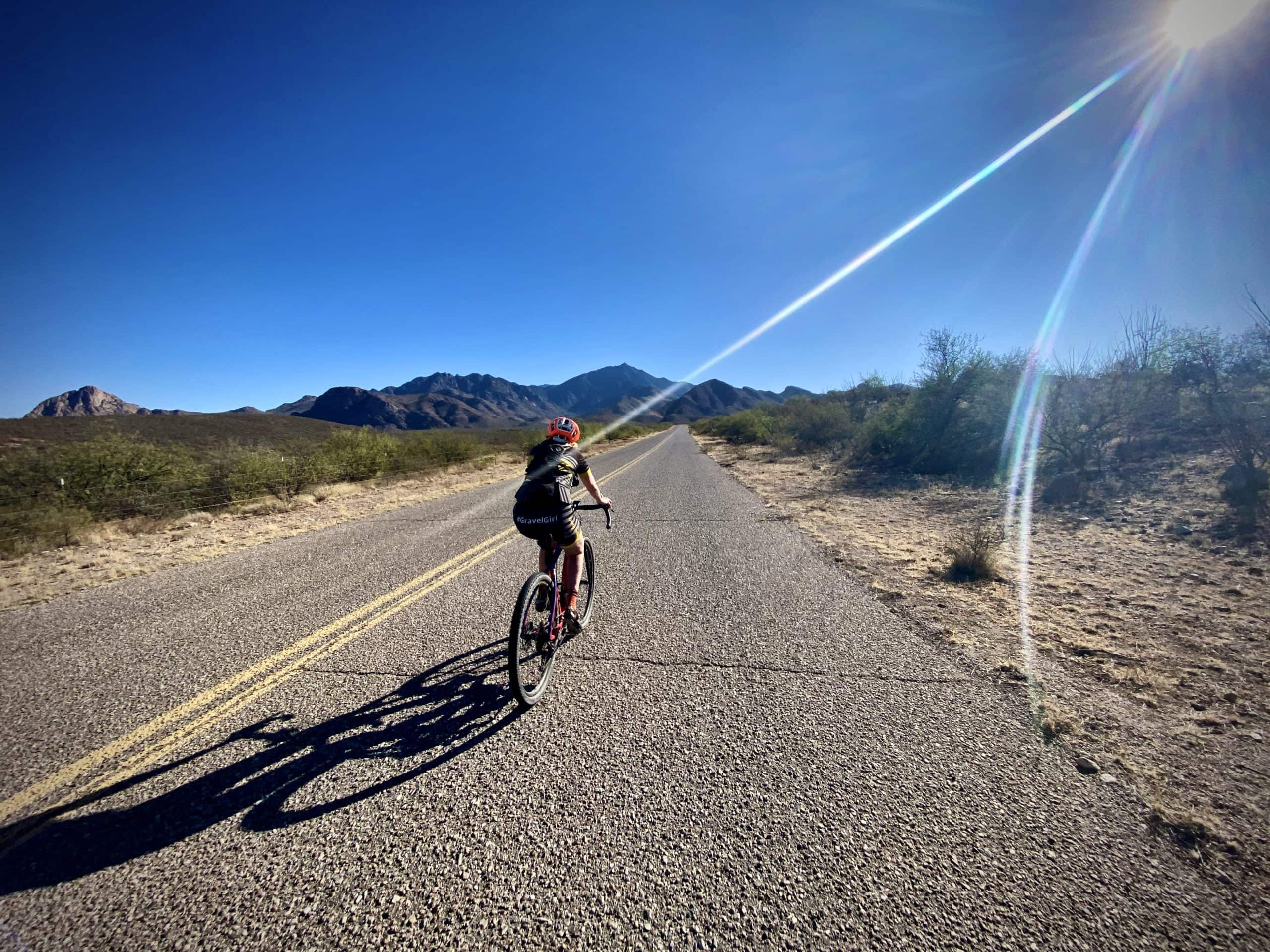 Cyclist on the paved road section leading to the observatory at Mt Hopkins.