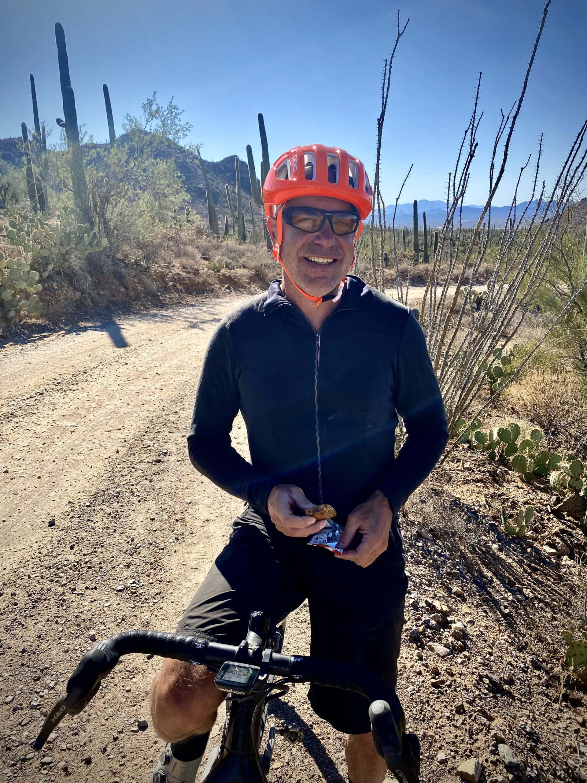 Captain O getting a bite to eat on his gravel bike in Saguaro National park.