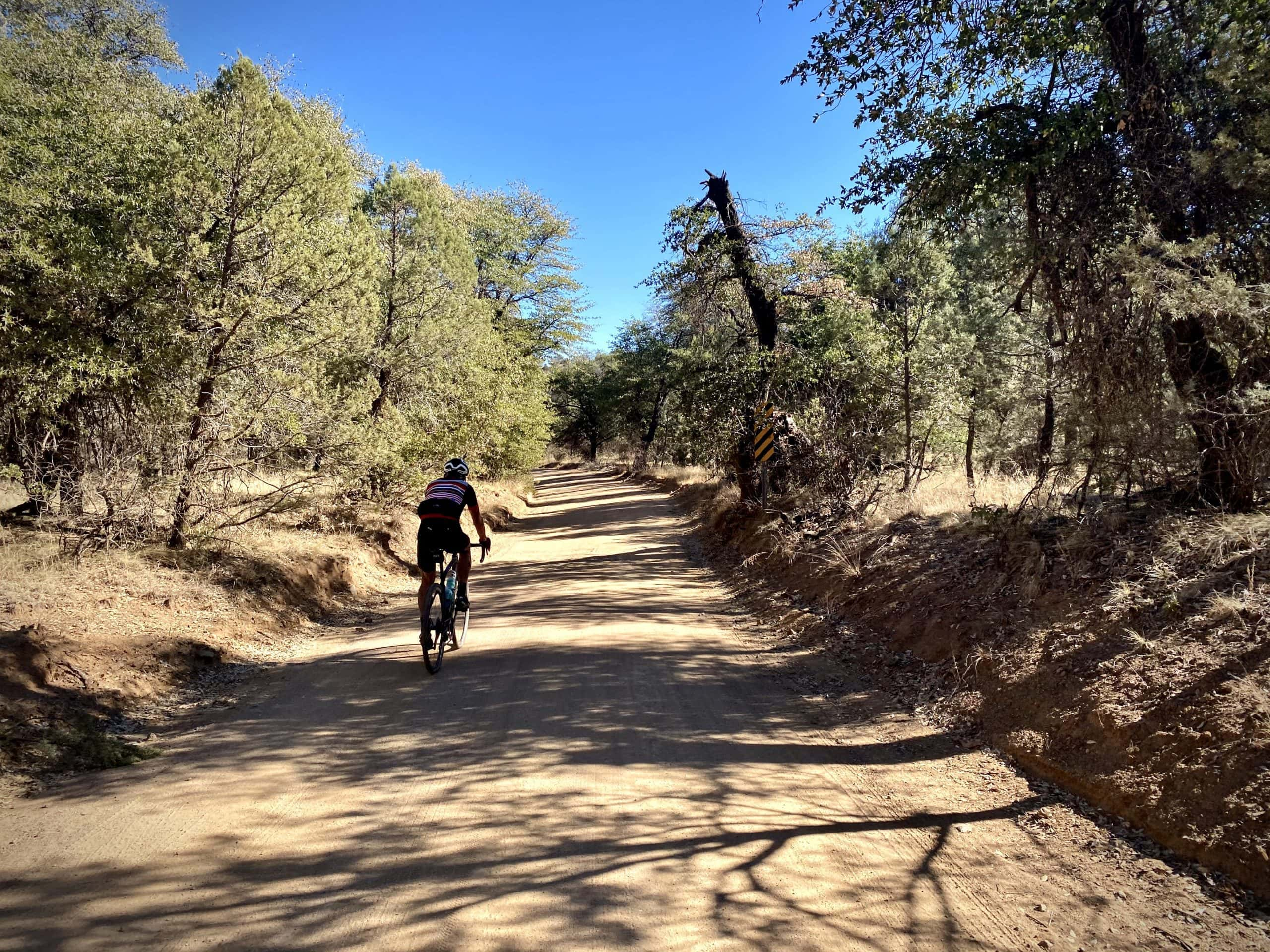 Cyclist on Apache road near the ghost town of Mowry.