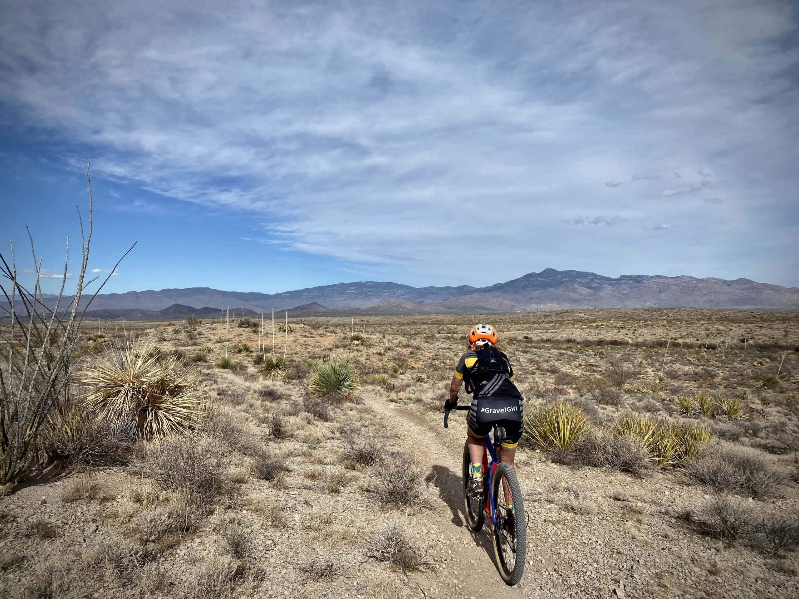 Gravel Girl riding north on the AZT with the Rincon Mountains in the distance.
