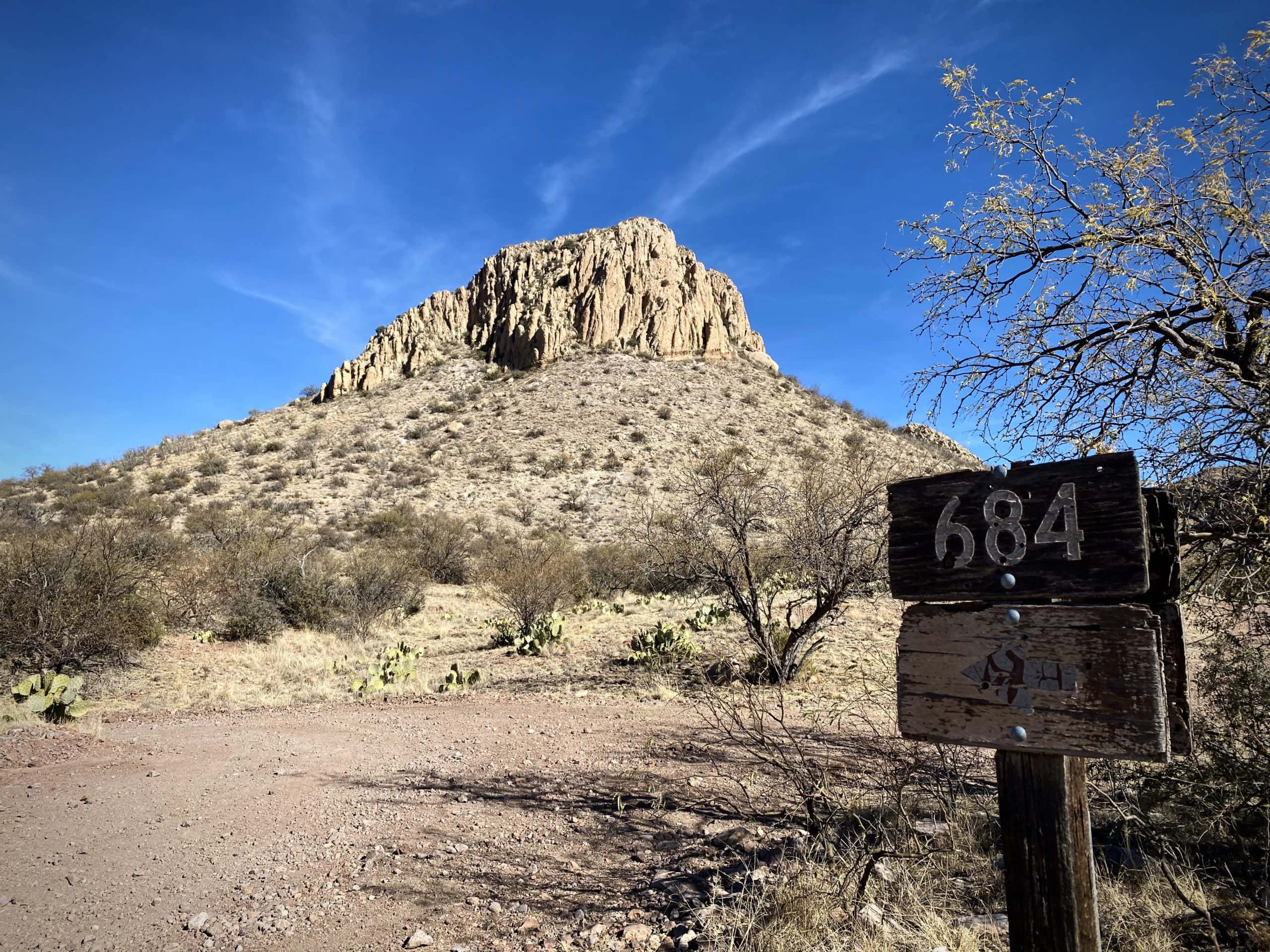 Tall peak with Forest Service sign for road 684 in Tumacacori Mountains south of Tucson.