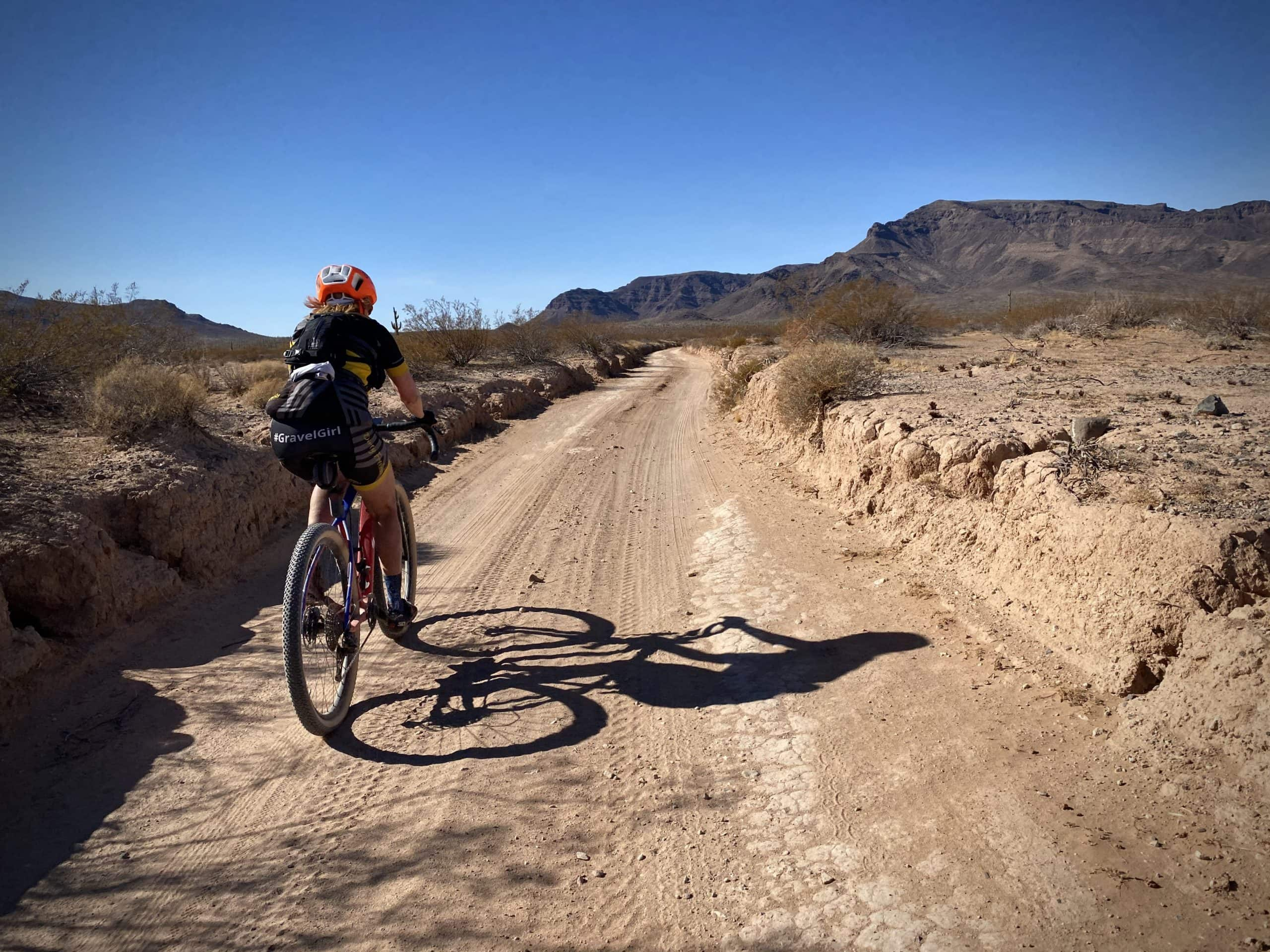Cyclist in deep gorged gravel road section in Cabeza Prieta NWR.