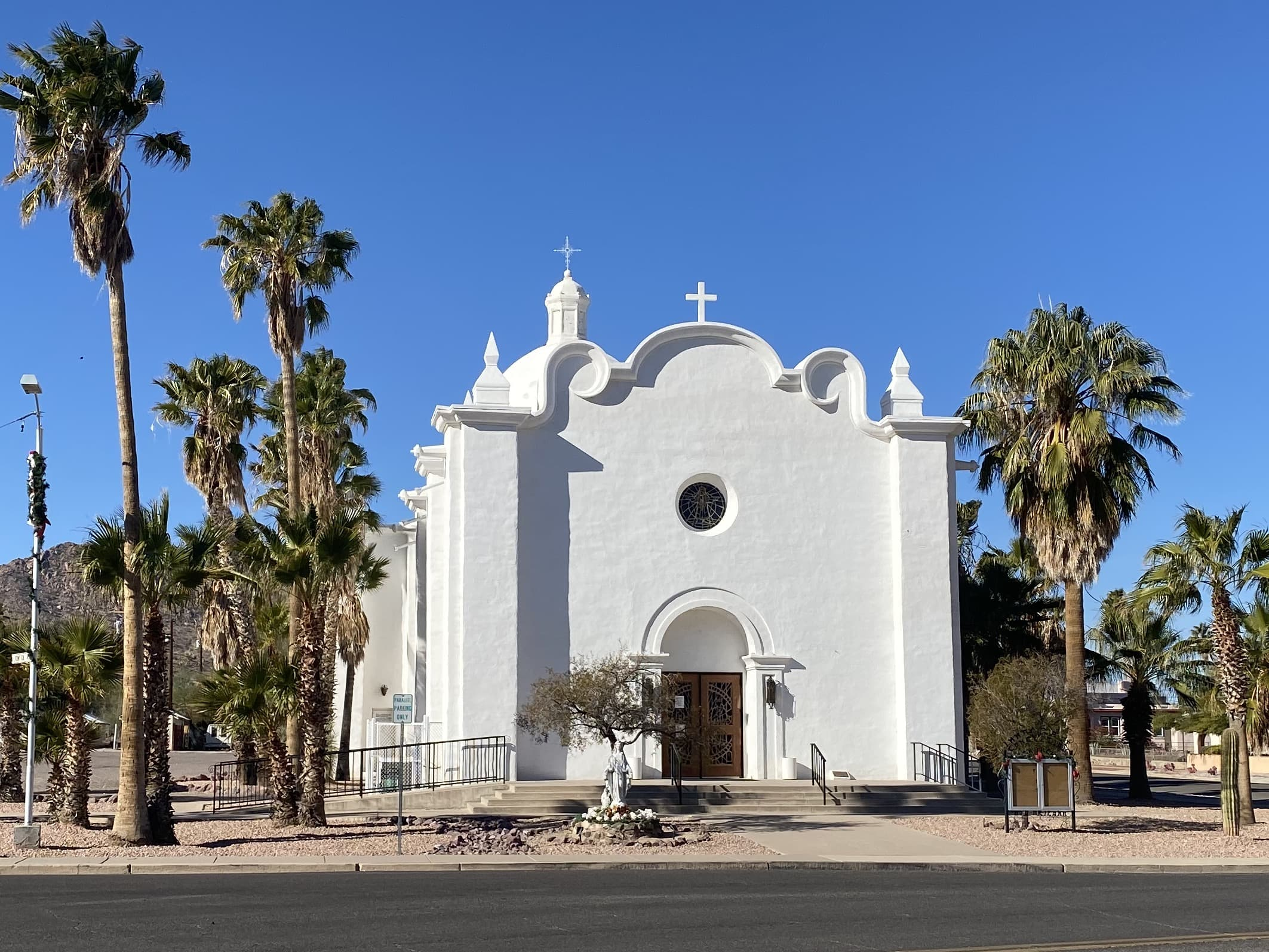Historic white church across the street from the Ajo town plaza.