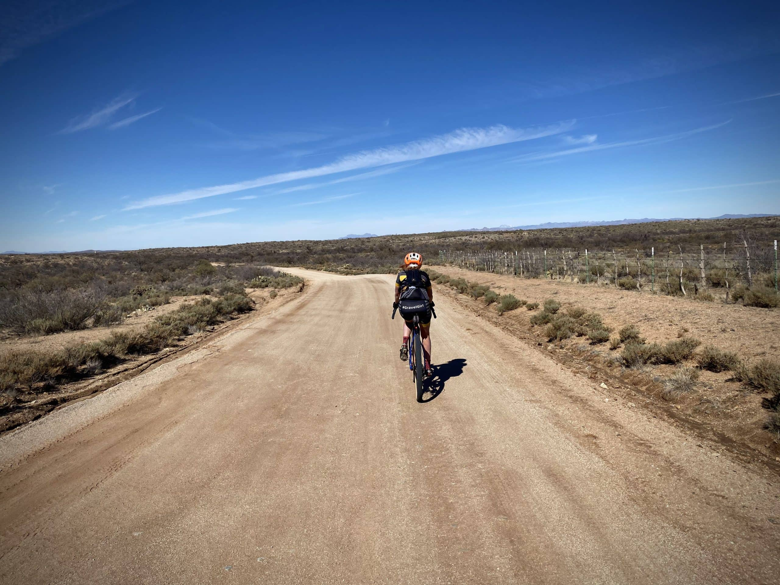 Woman cyclist on Barkersville road south of Florence, Arizona.
