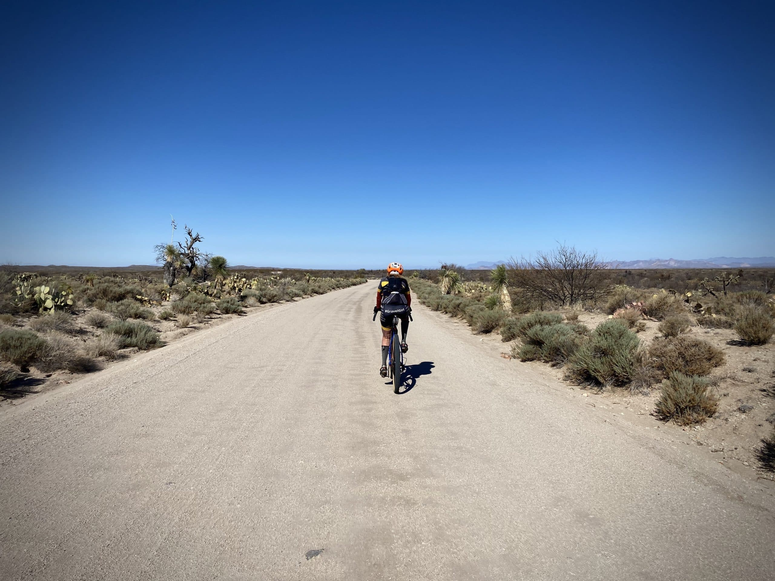 Woman cyclist on Barkersville Road out of Florence, AZ.