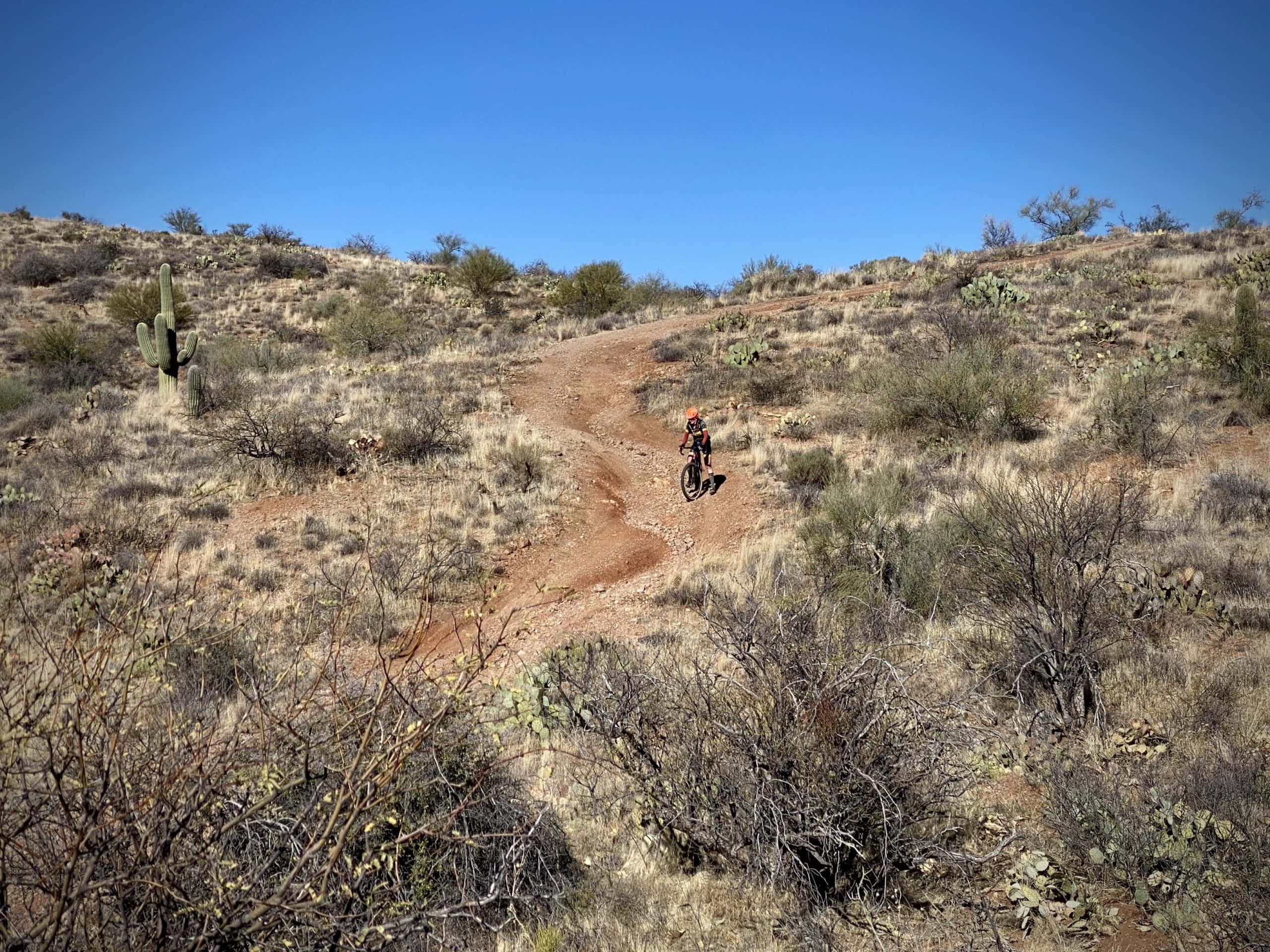 Gravel Girl descending a rugged section of dirt road in the Sonoran desert between Tucson and Florence.