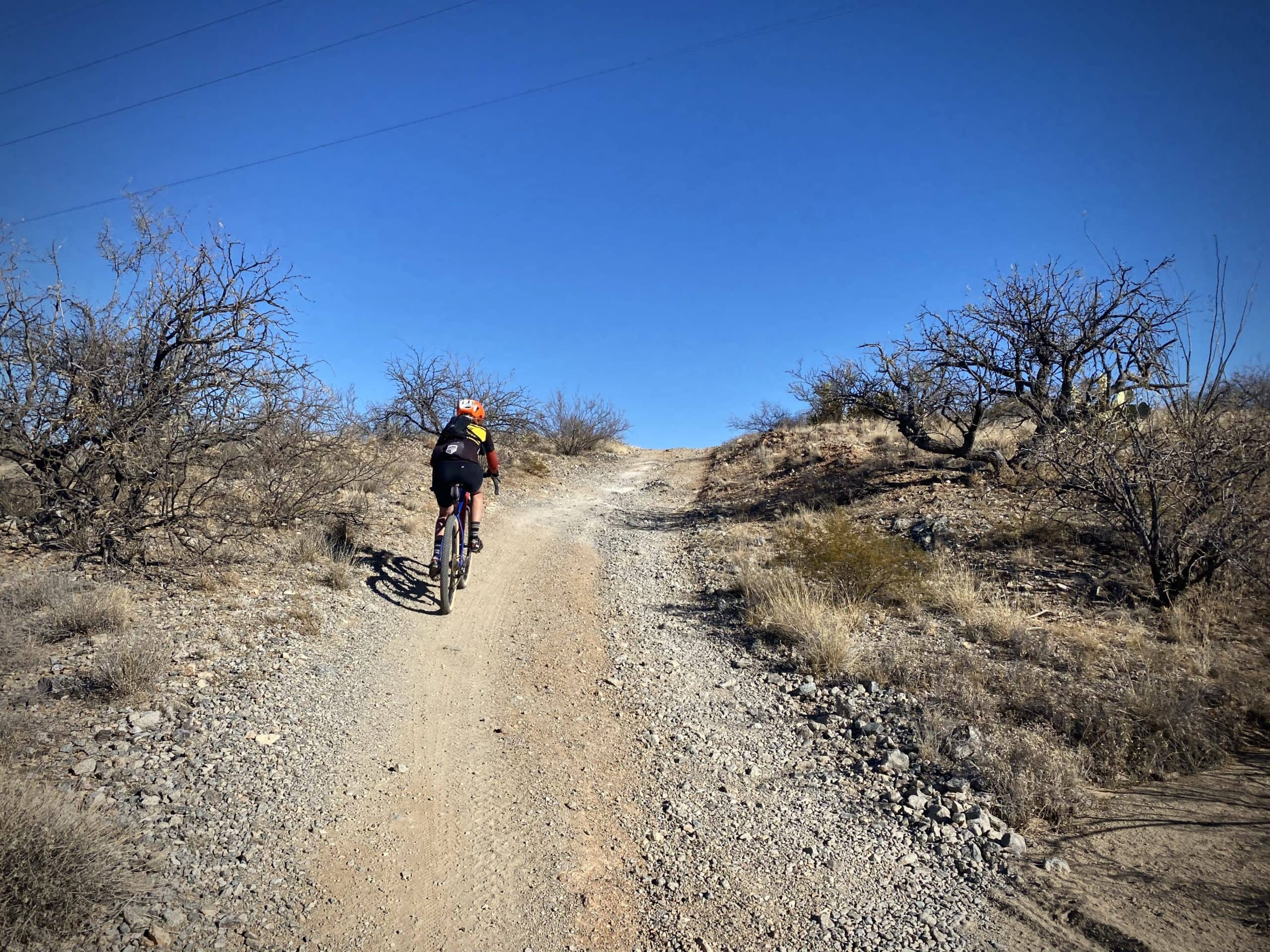 Cyclist climbing loose, gnarly dirt road south of Tucson.