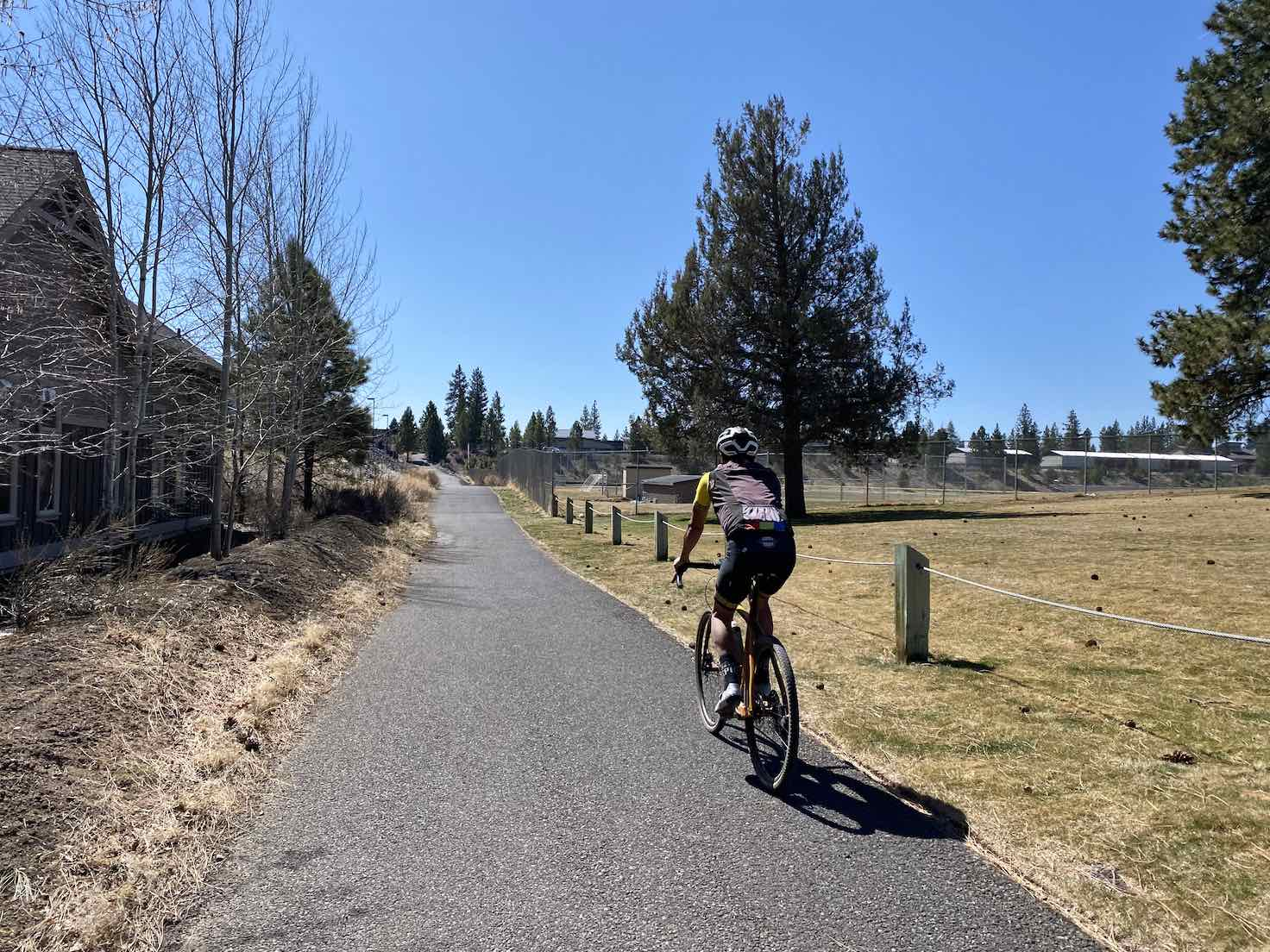 Cyclists on the Discovery pathed multi-use path in Bend, OR.