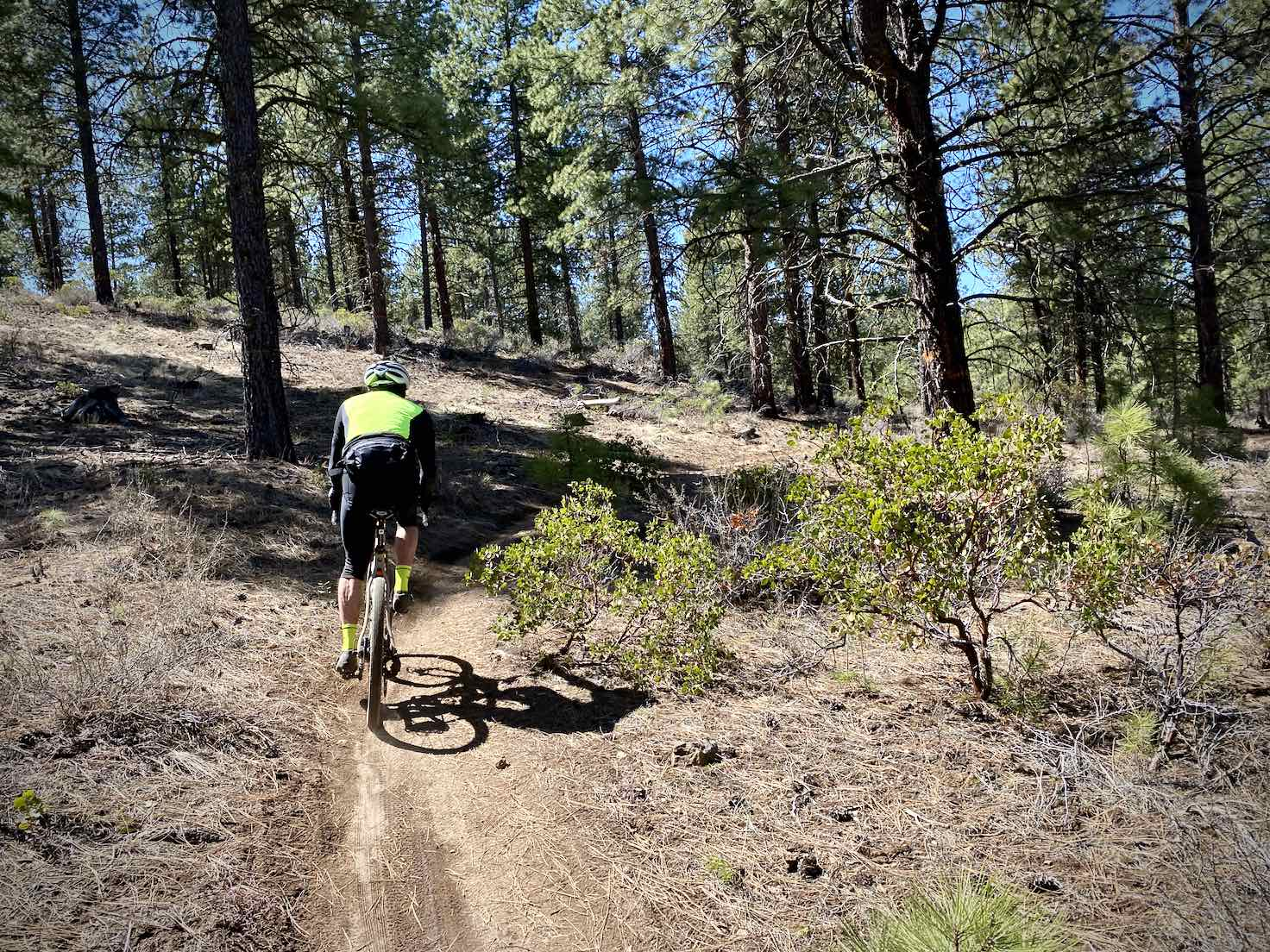 Gravel cyclist on the ELV single-track trail near Bend, OR.