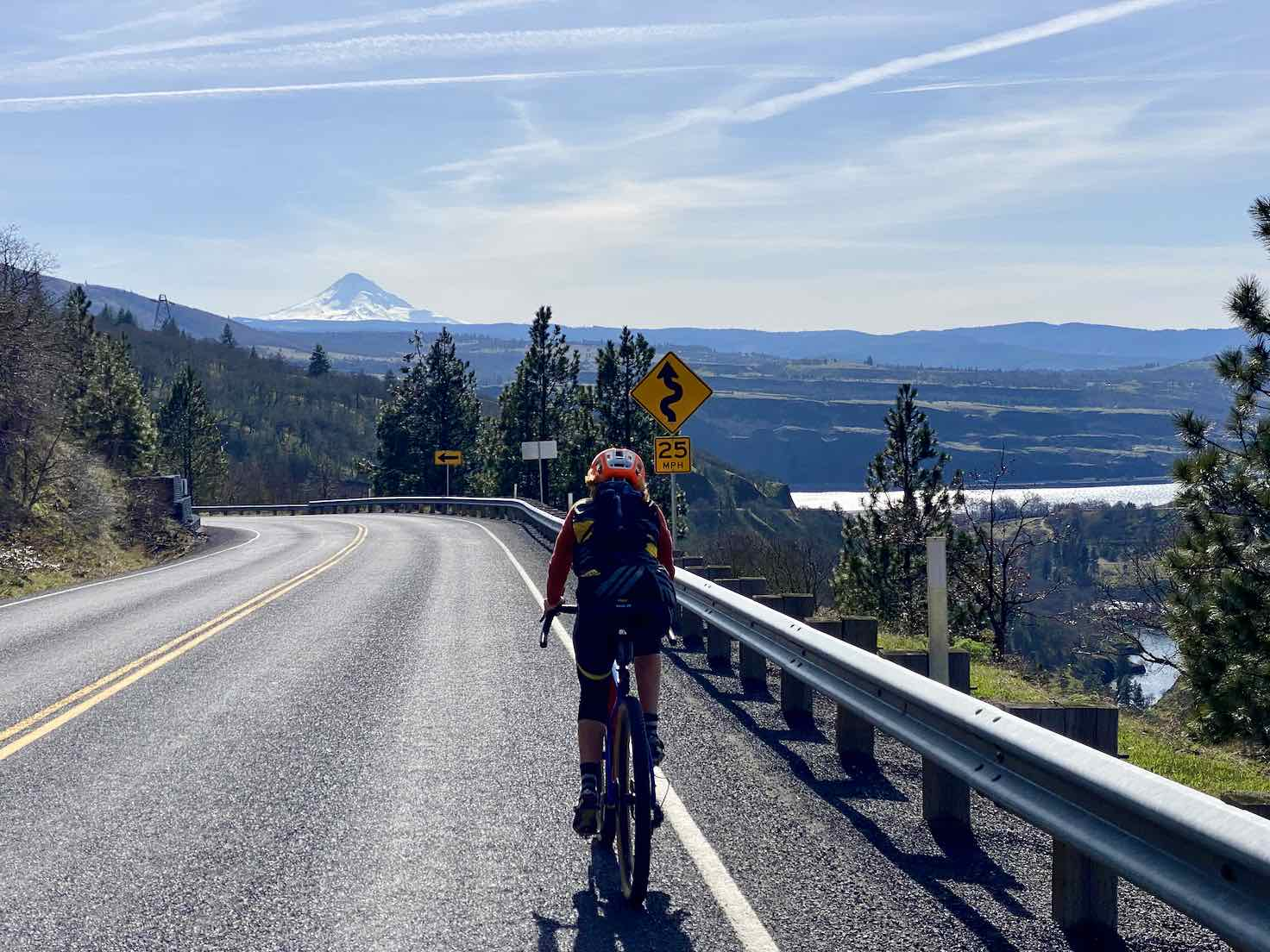 Expansive view from cyclists perspective as descending the Highway 142.