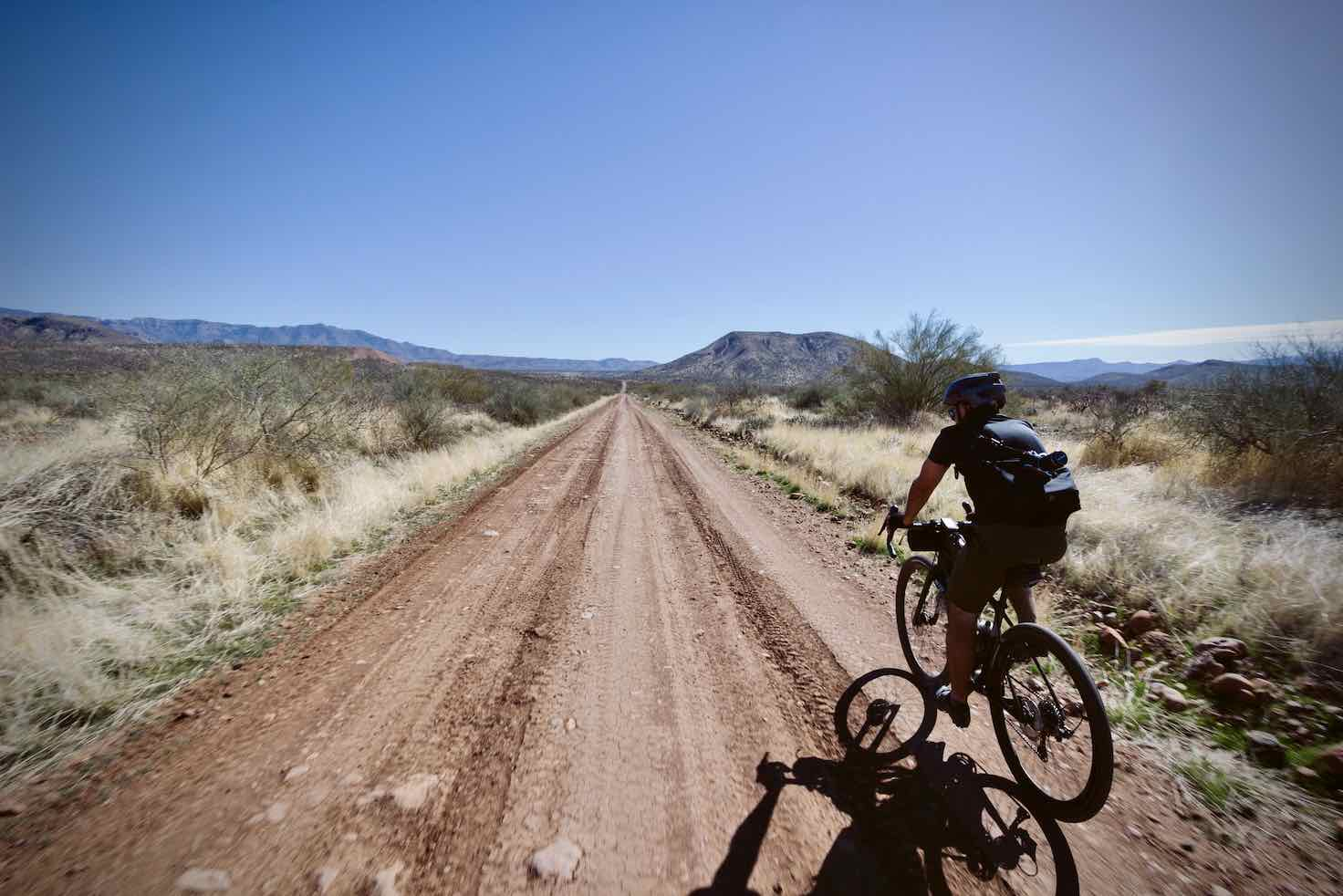 The gravel road is in excellent shape! (photo: Wyatt Spalding). Gravel cyclists going fast.
